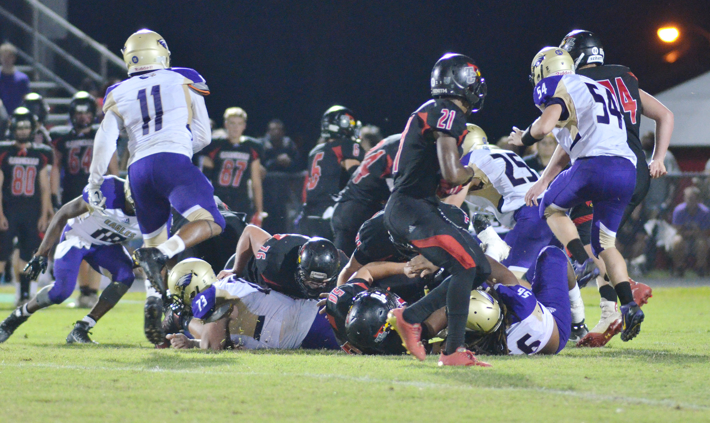 CHS football players tackle.