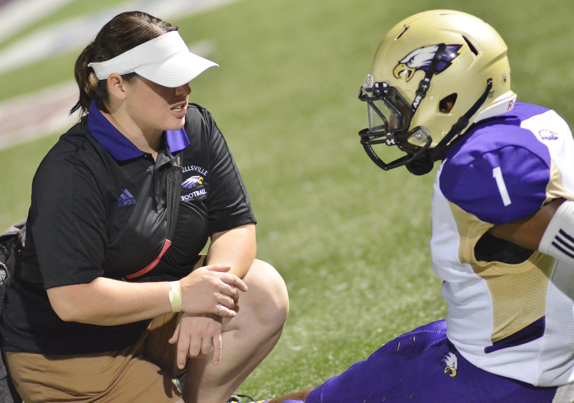 CHS athletic trainer Rebecca Cravens talks to junior Charlie Pettigrew during the game.