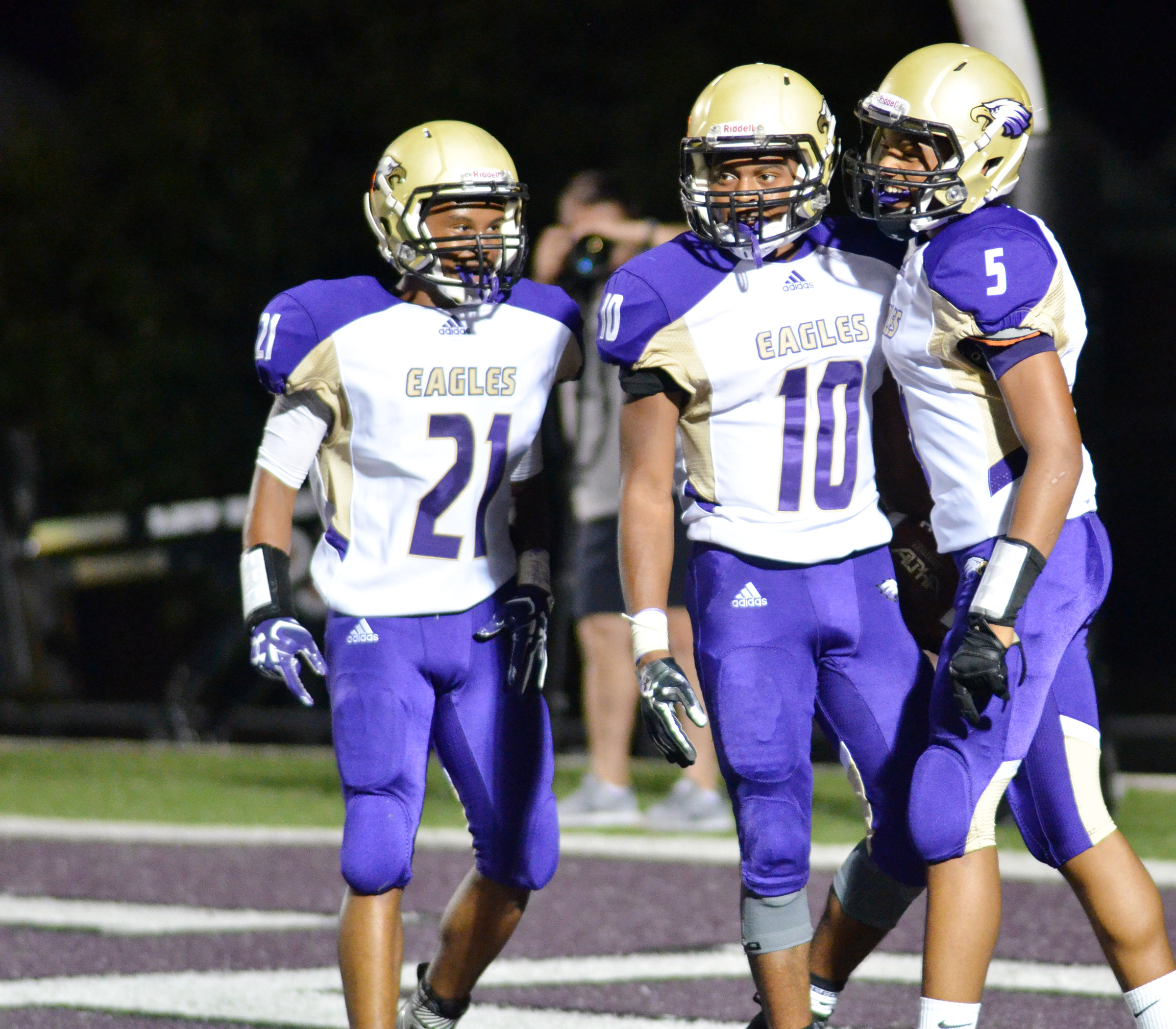 From left, CHS junior Daesean Vancleave, senior Devonte Cubit and sophomore Malachi Corley celebrate a touchdown.