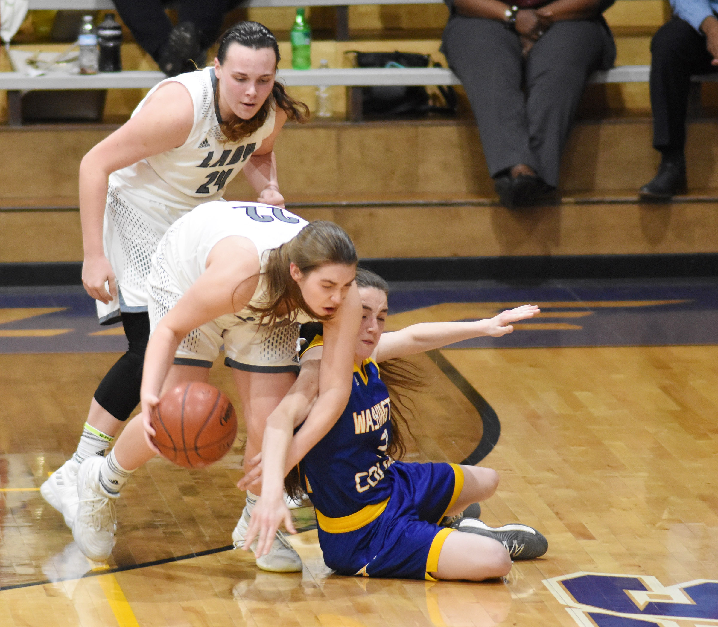 CHS sophomore Katelyn Miller, in back, and freshman Abi Wiedewitsch fight for the ball.
