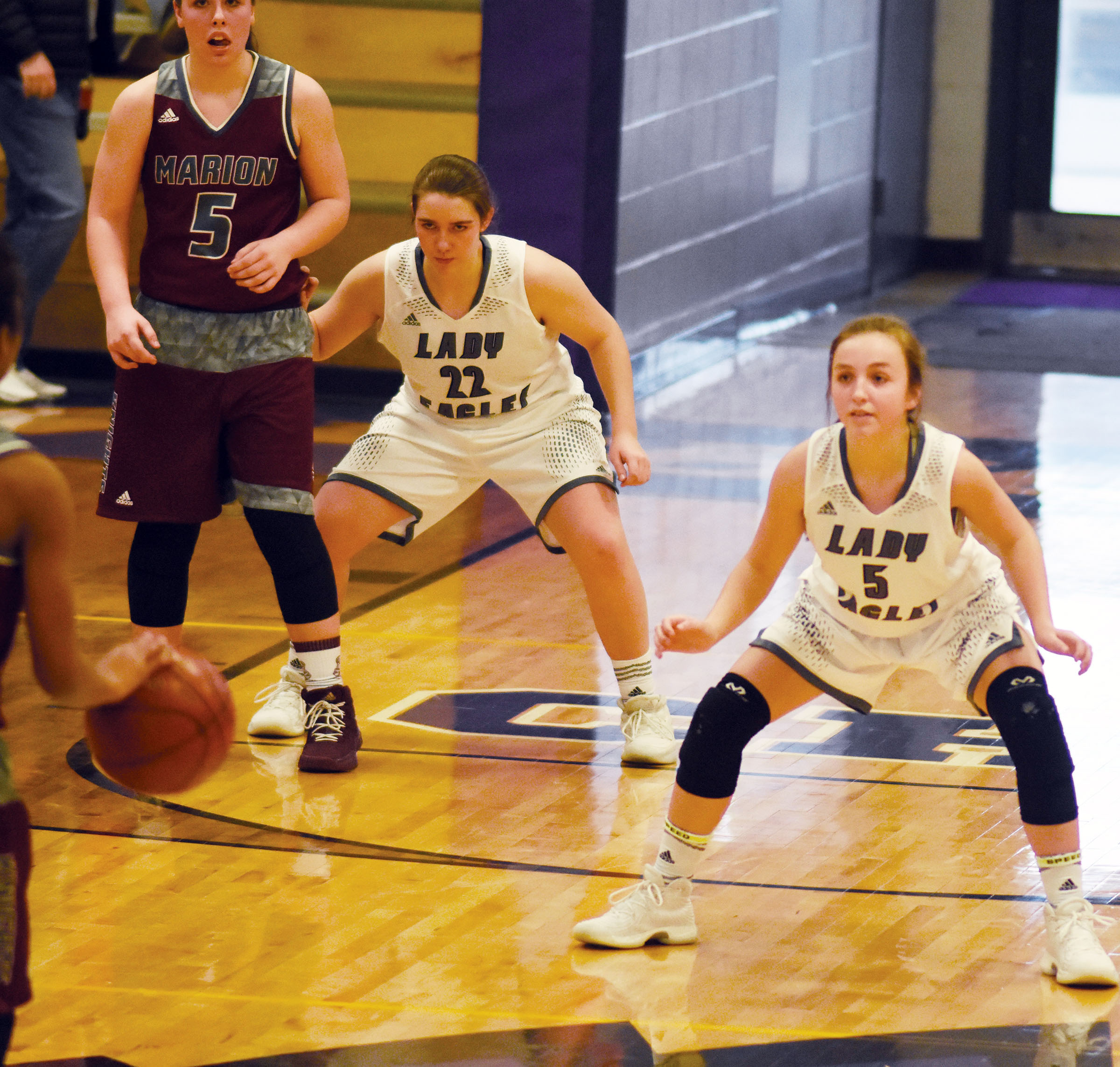 CHS freshman Abi Wiedewitsch, at left, and Campbellsville Middle School eighth-grader Lainey Watson play defense.