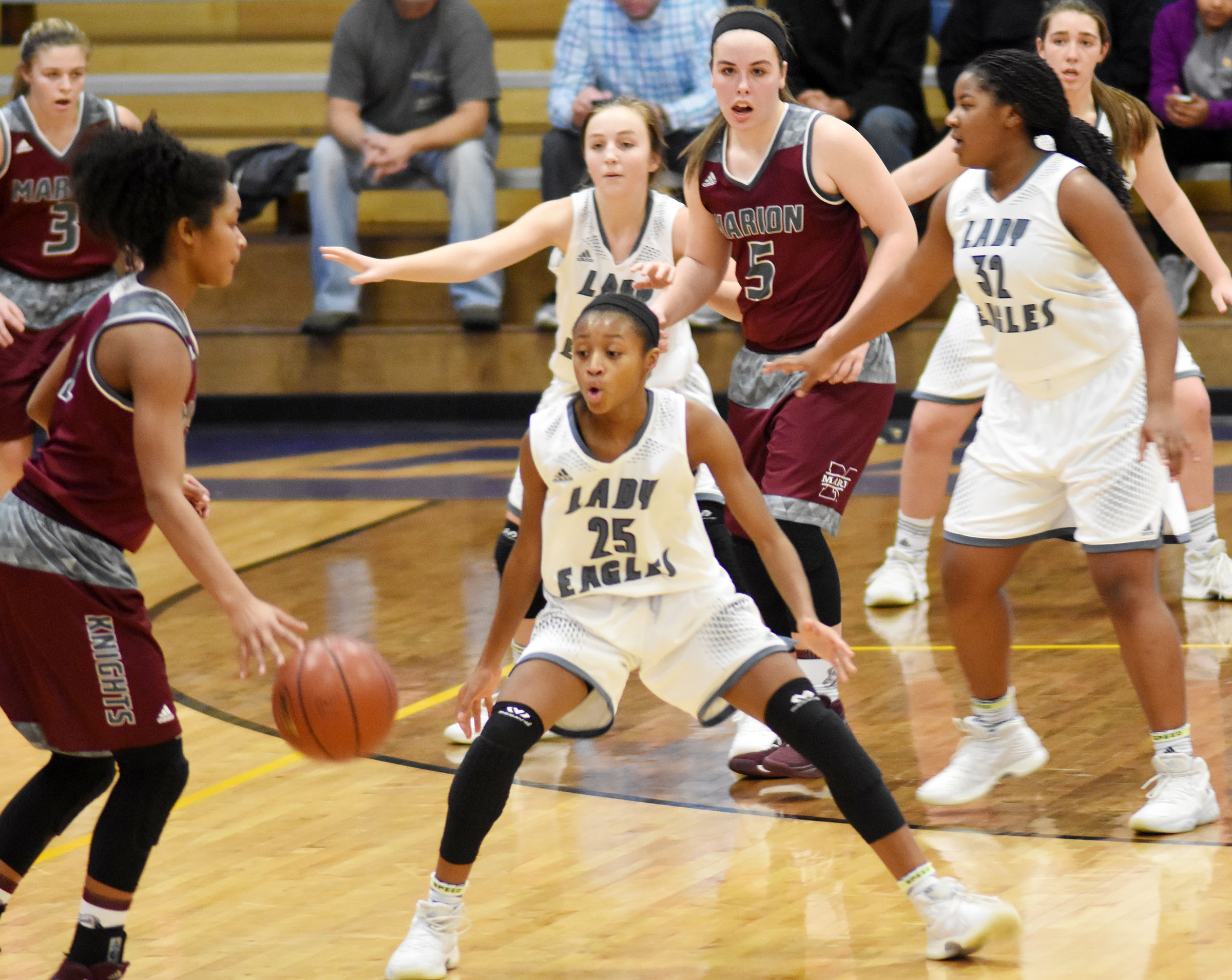 Campbellsville Middle School eighth-grader Bri Gowdy and her teammates play defense.