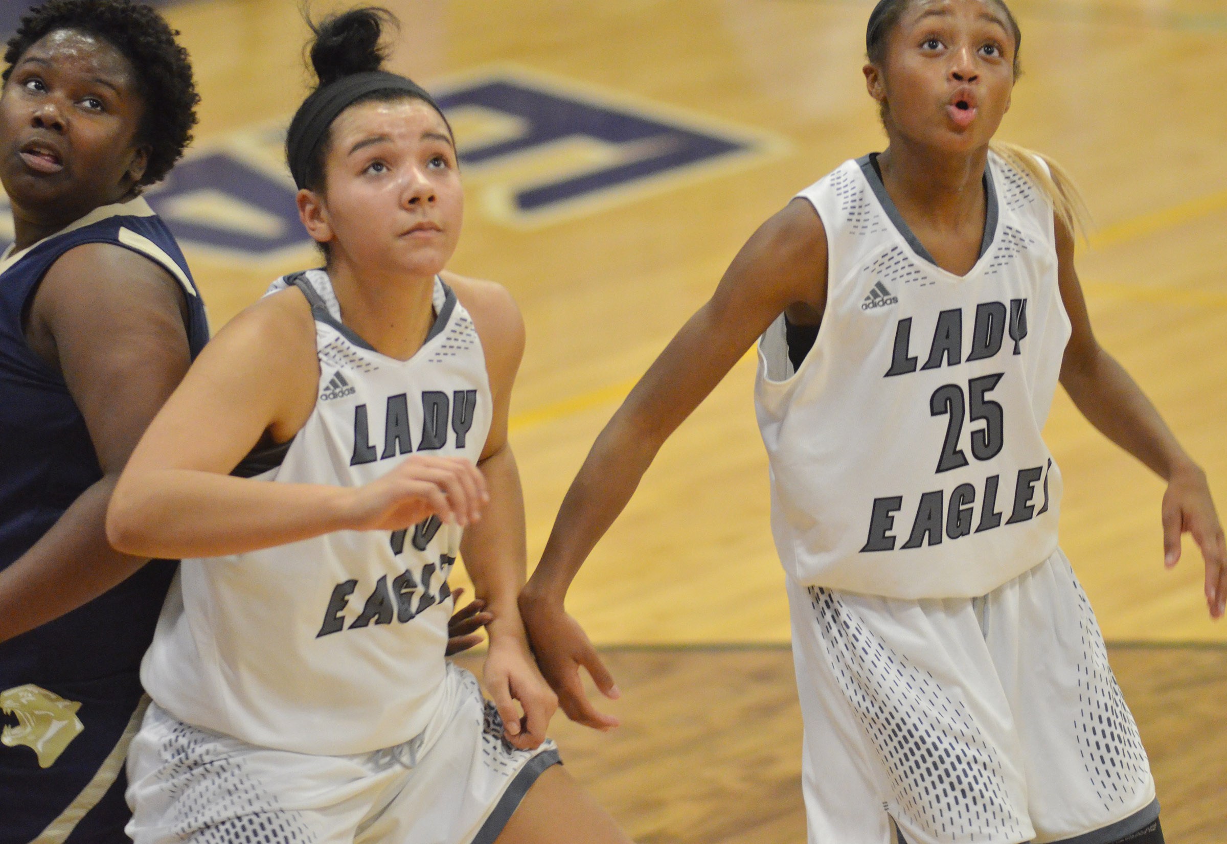 CHS junior Kalisha Murphy, at left, and Campbellsville Middle School eighth-grader Bri Gowdy watch the ball.