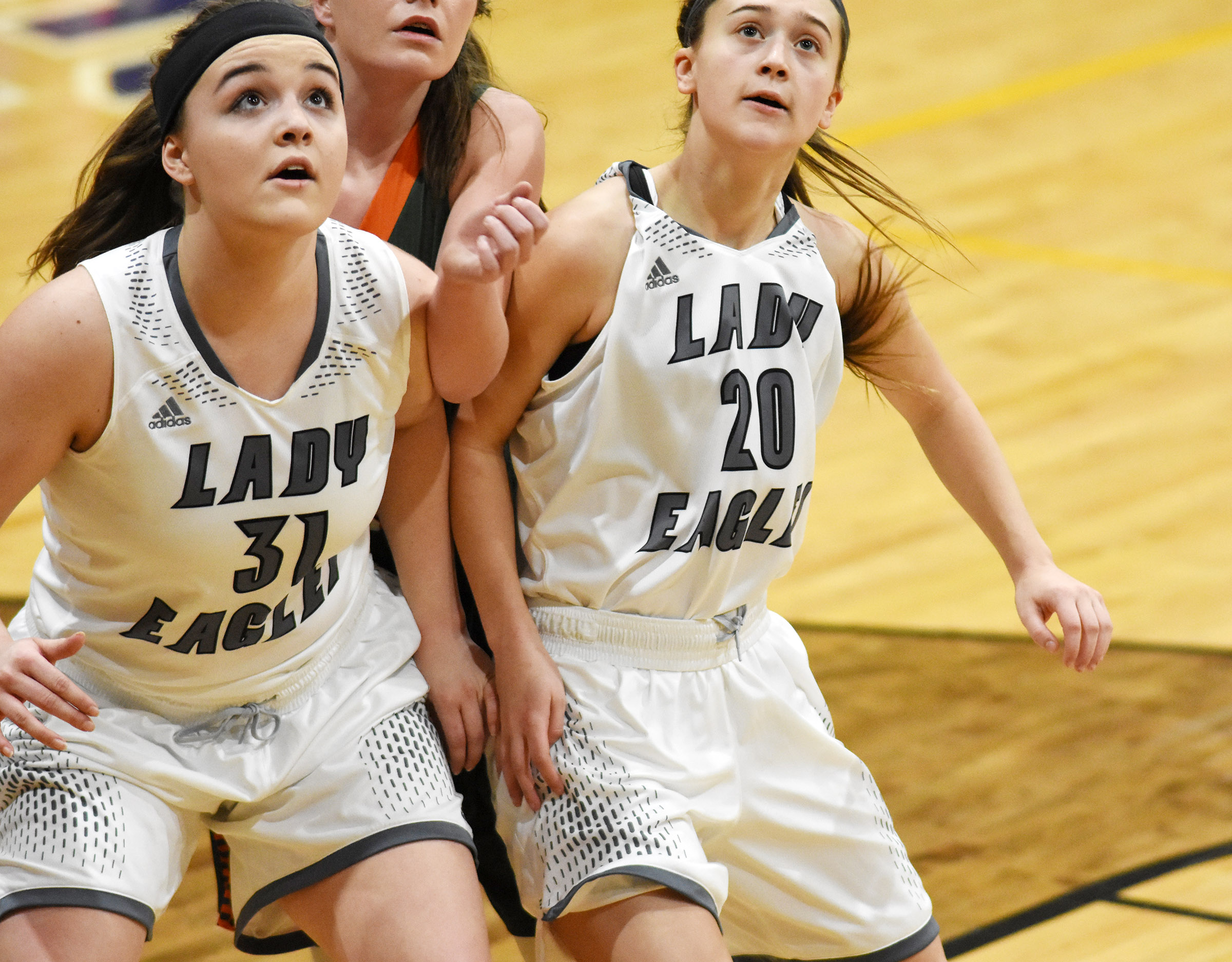 CHS freshman Kenzi Forbis, at left, and sophomore Bailey Thompson look for a rebound.
