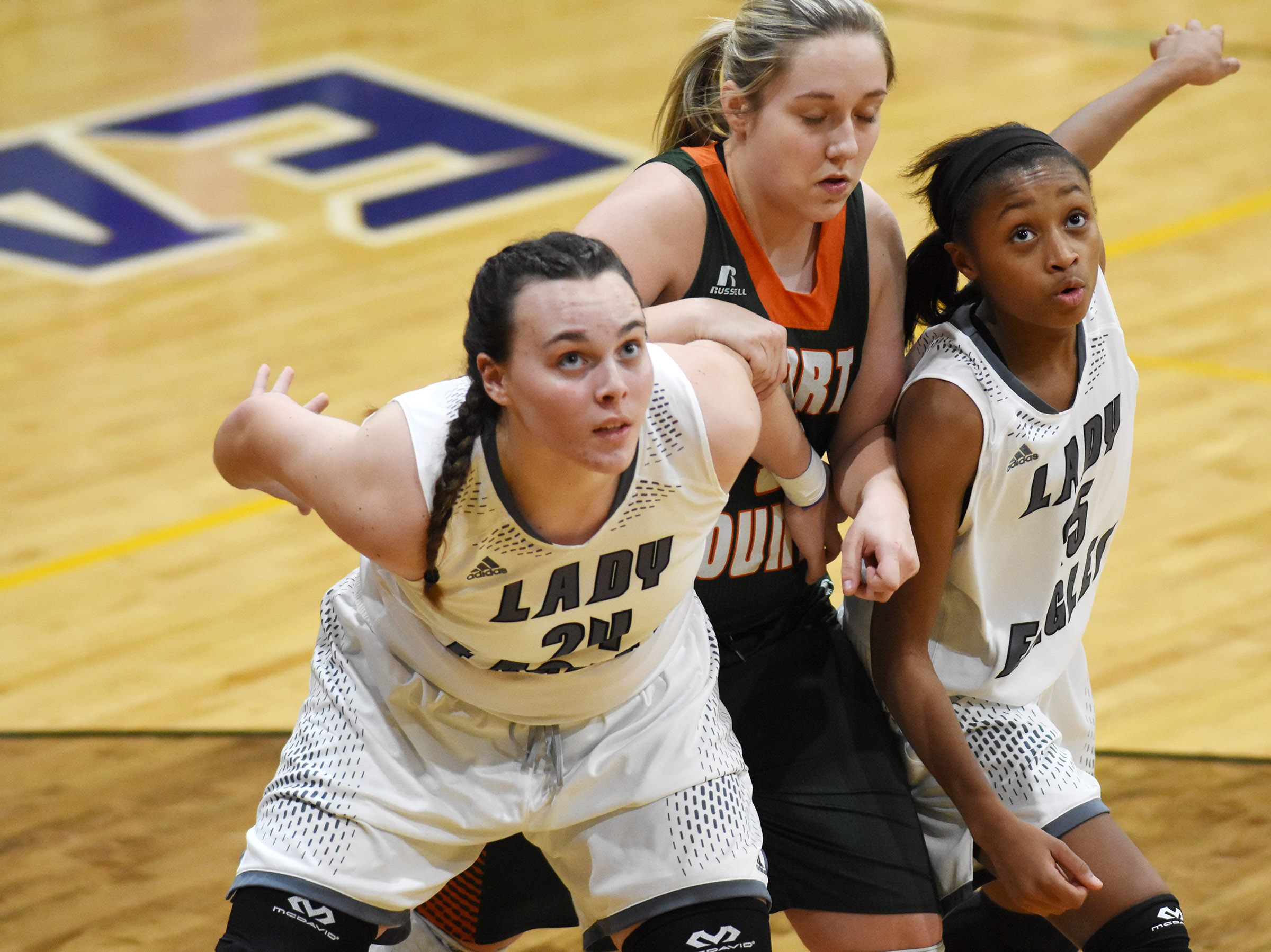 CHS sophomore Katelyn Miller, at left, and Campbellsville Middle School eighth-grader Bri Gowdy fight for the rebound.