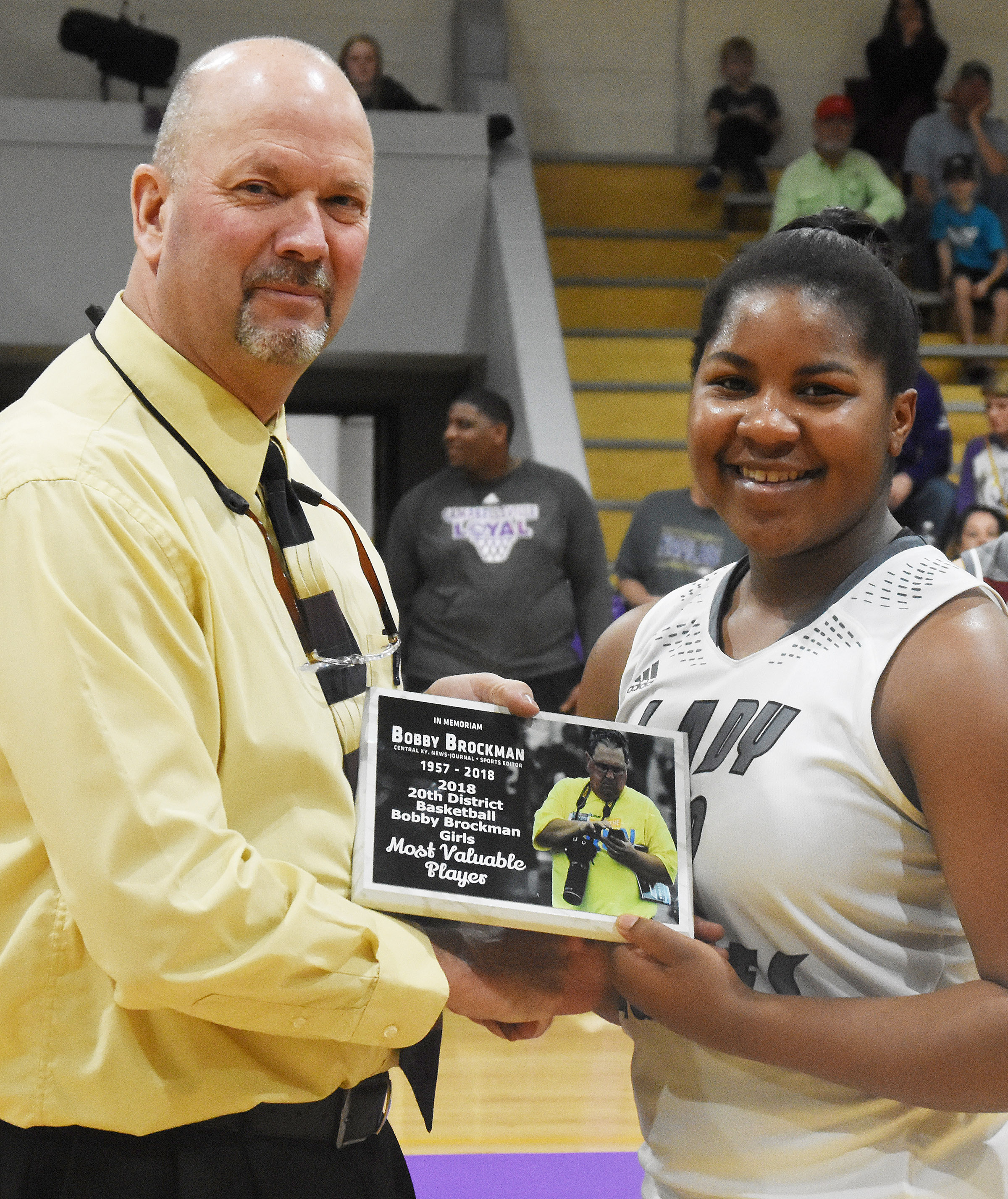 CHS senior Nena Barnett is presented the Bobby Brockman Most Valuable Player award by CHS Athletic Director Tim Davis.