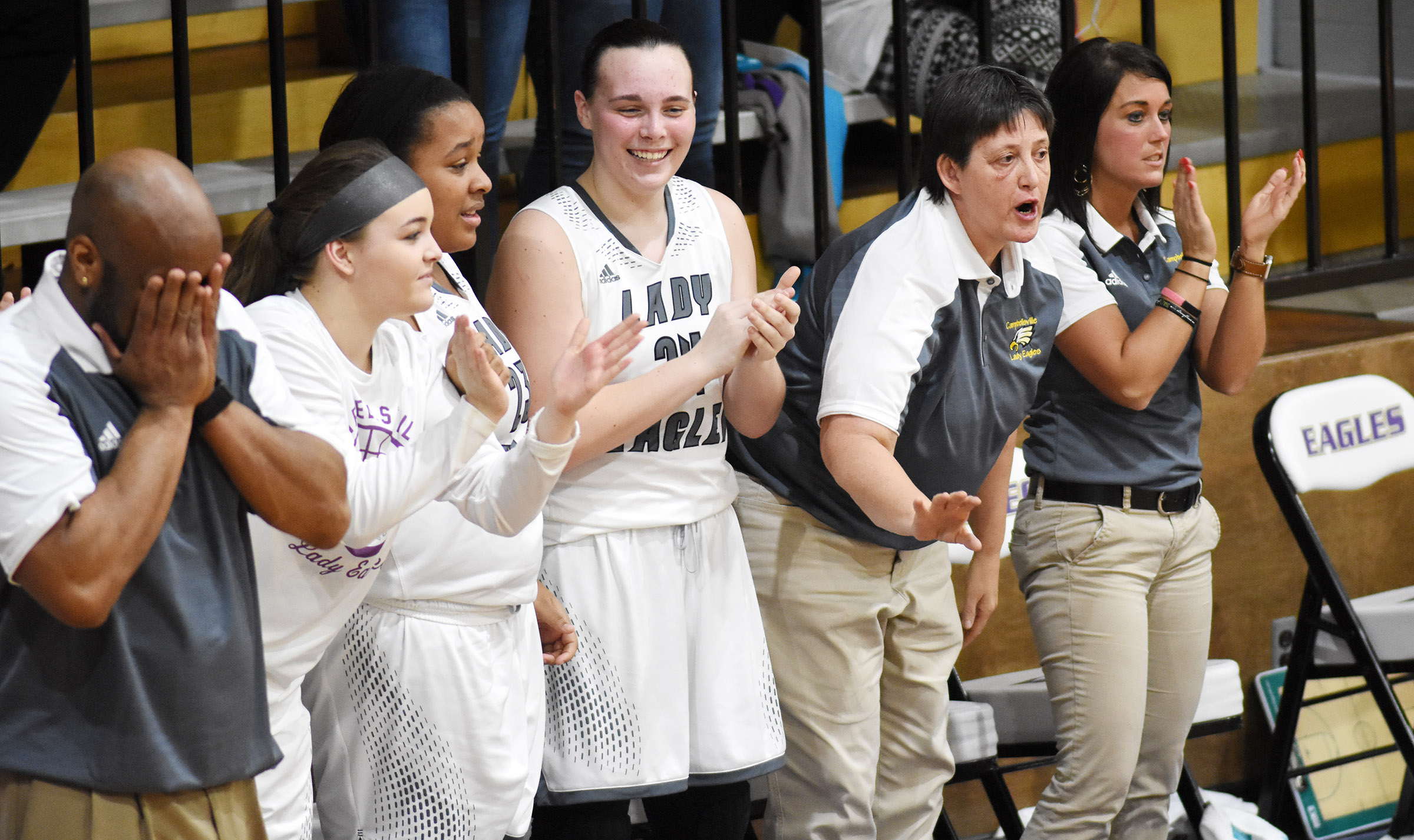 CHS girls' basketball coaches and players cheer as the clock expires.