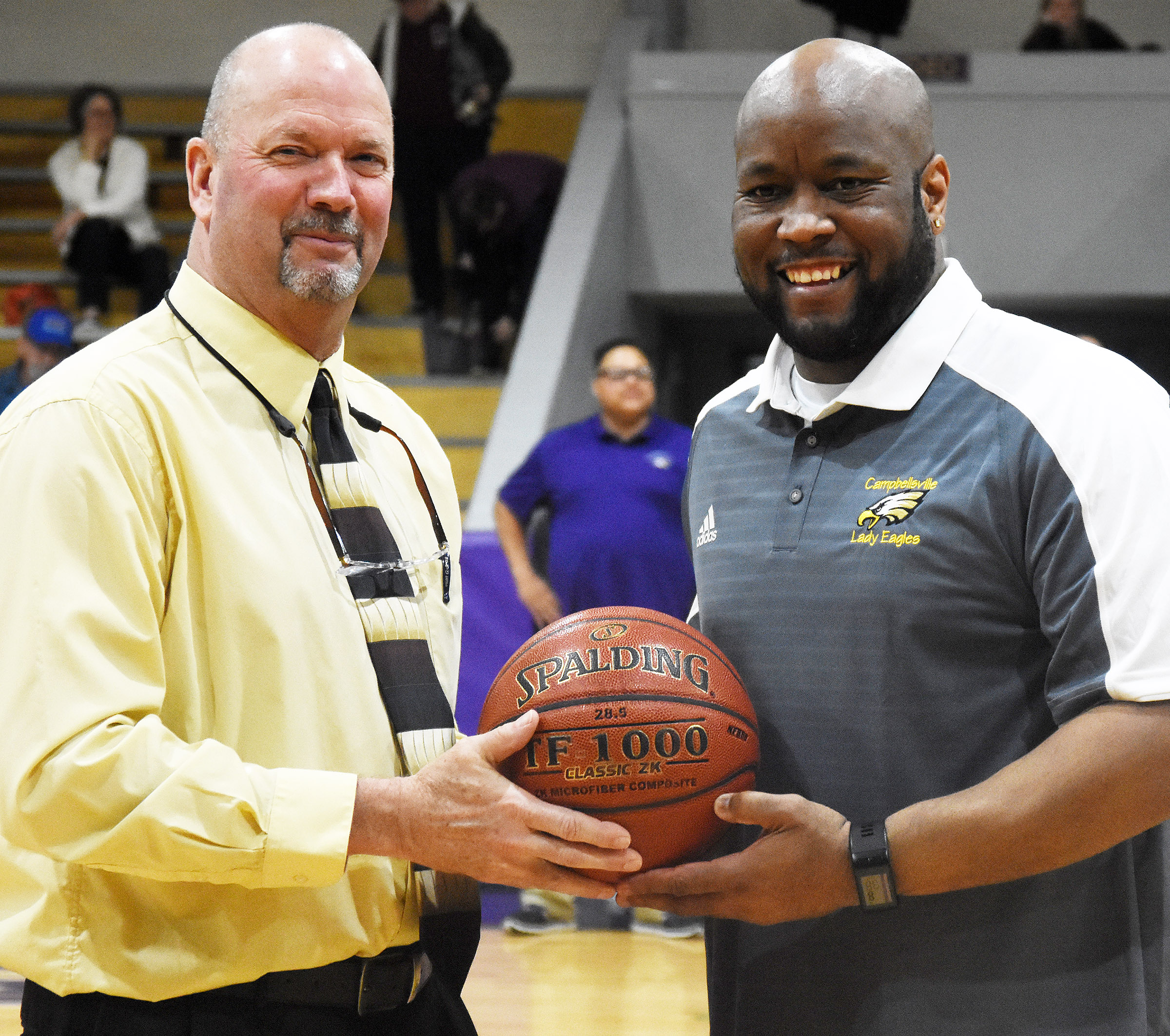 CHS girls' basketball head coach Anthony Epps, at right, receives the game ball from CHS Athletic Director Tim Davis.