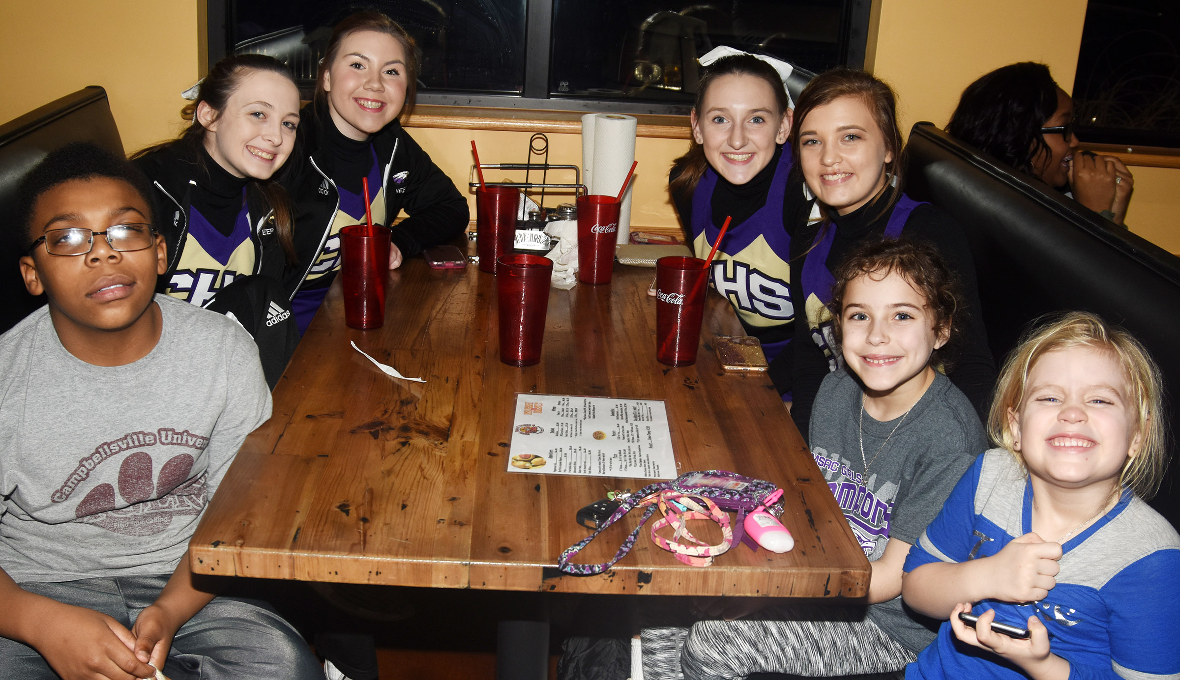 CHS cheerleaders and fans enjoy a celebration at Wings, Pizza N Things.