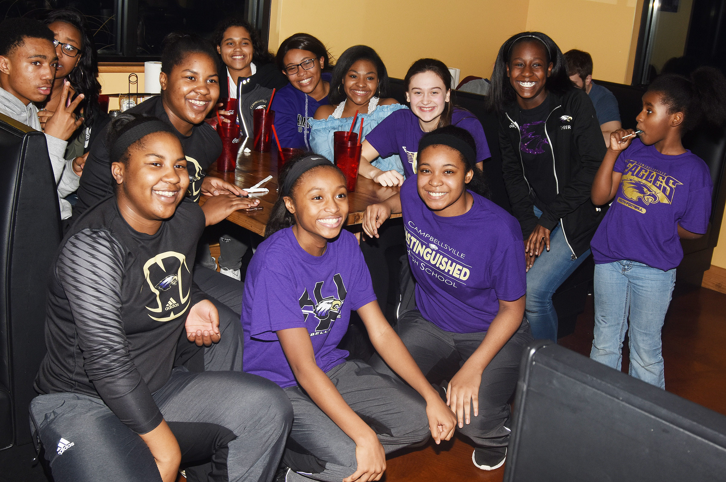 CHS girls' basketball players and their friends enjoy a celebration at Wings, Pizza N Things.
