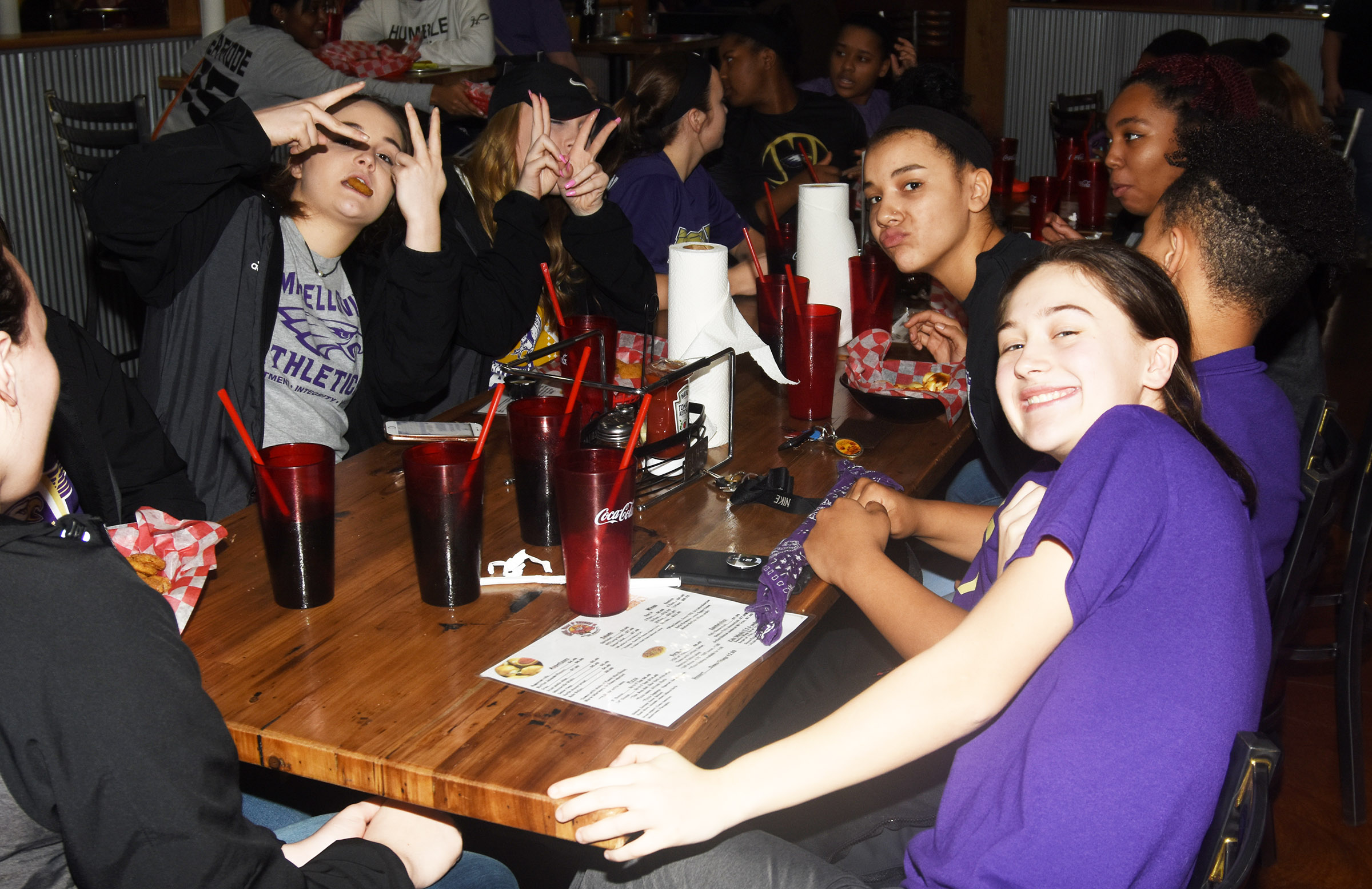 CHS girls' basketball players enjoy a celebration at Wings, Pizza N Things.