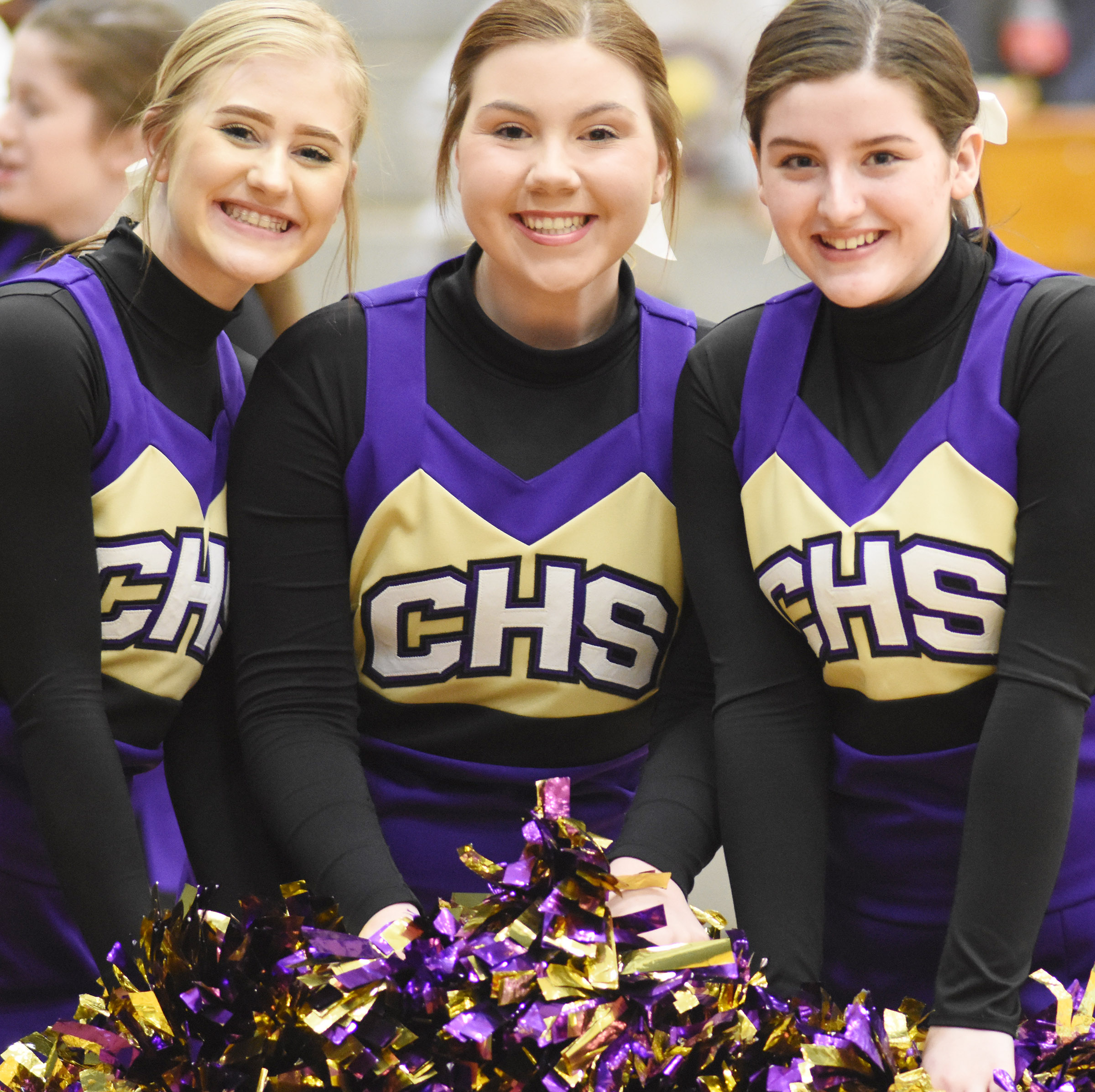 From left, CHS sophomores Isabella Osborne, Lauryn Agathen and Alli Wilson cheer for the Eagles.