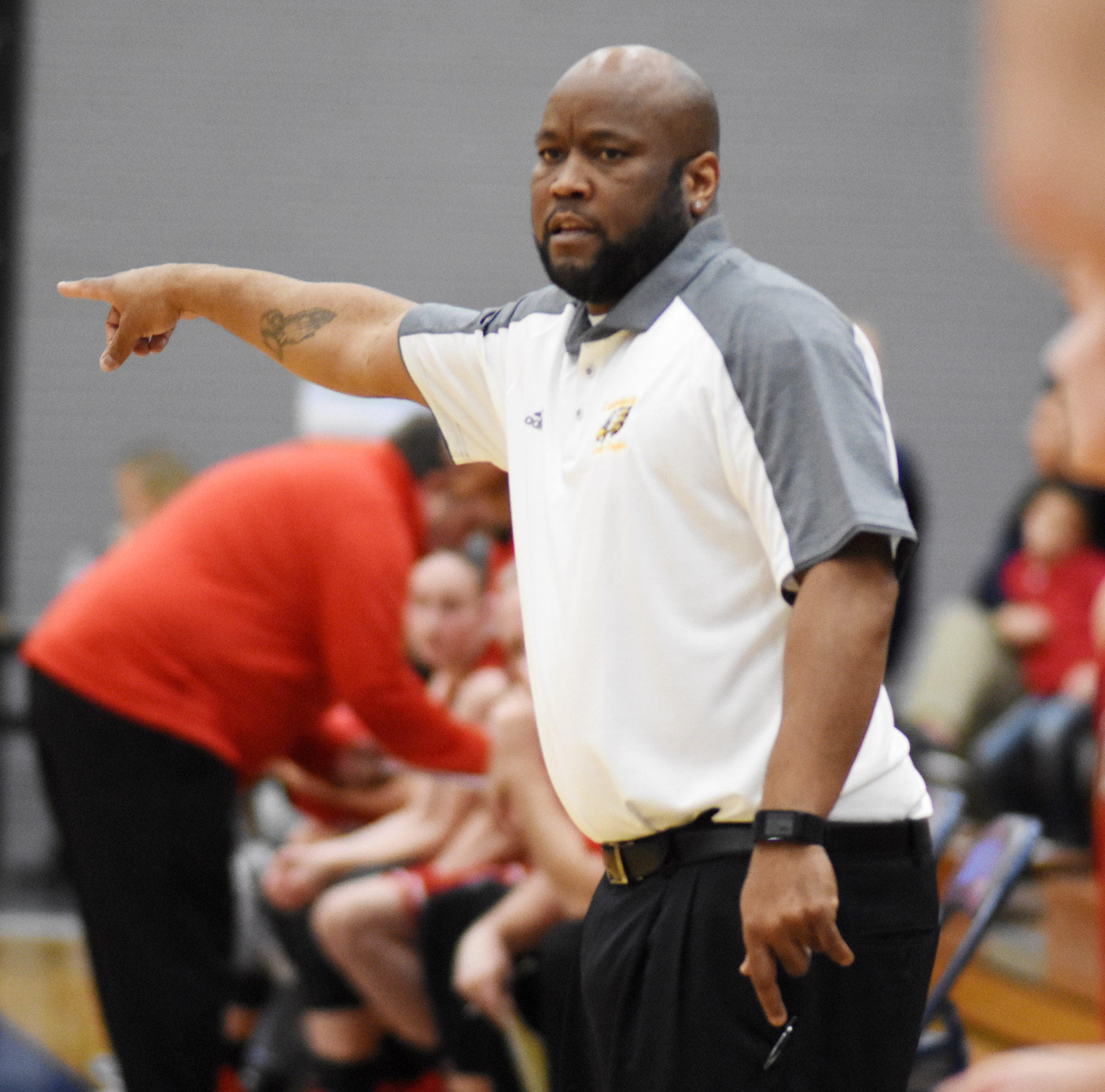CHS girls' basketball head coach Anthony Epps calls a play.