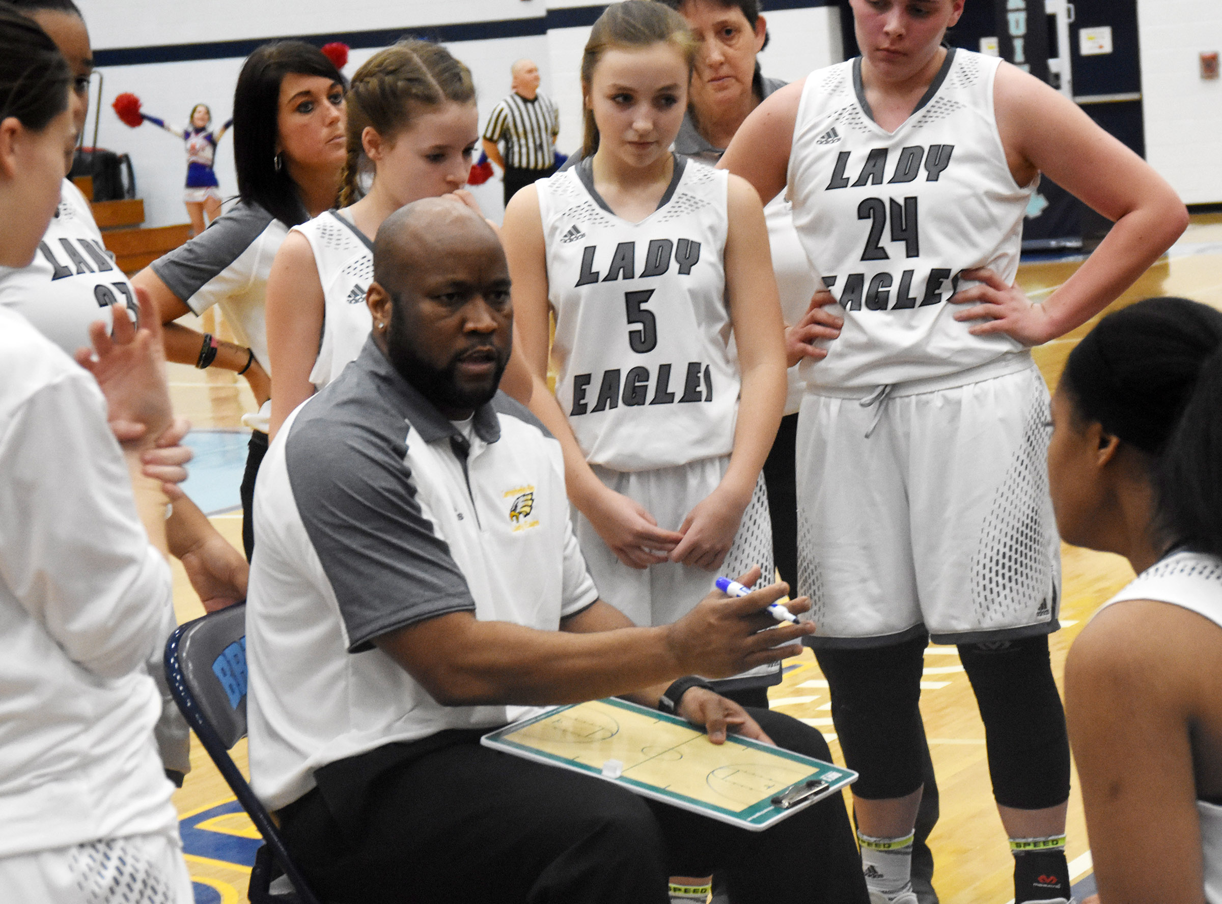 CHS girls' basketball head coach Anthony Epps talks to his players.