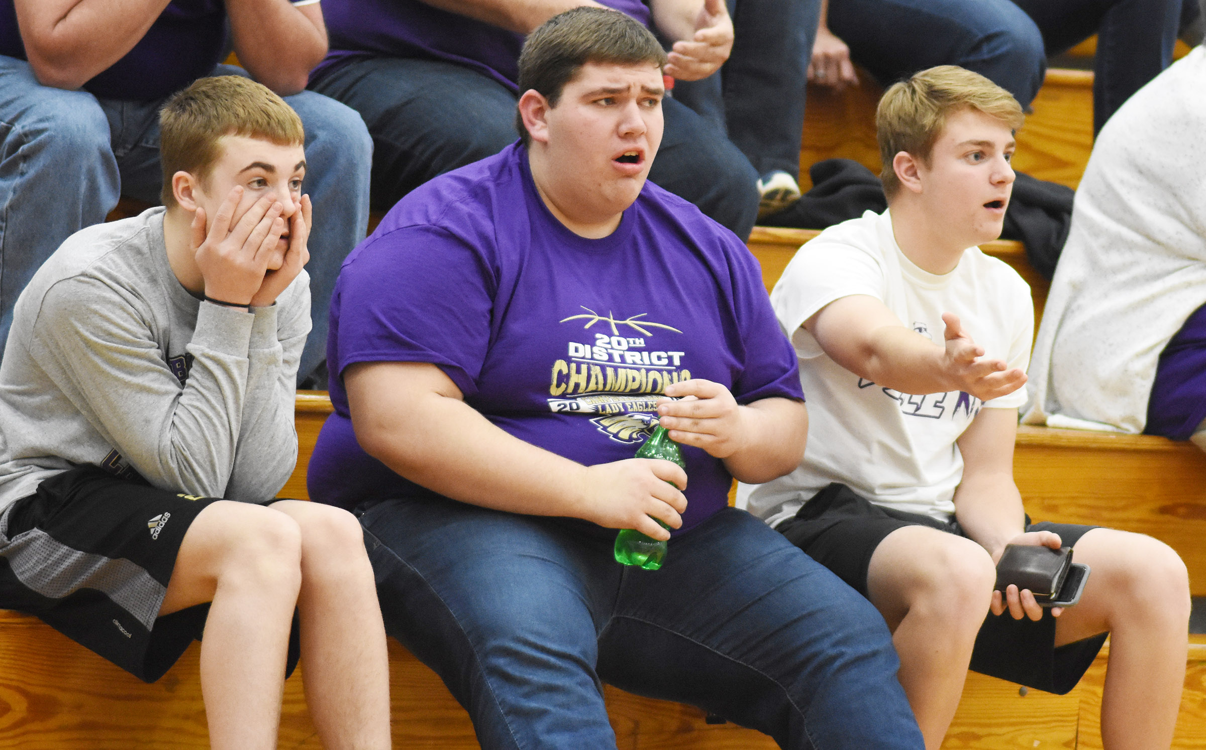 From left, CHS sophomore Tyler Gribbins and seniors Ryan Wiedewitsch and Alex Doss react to a call.
