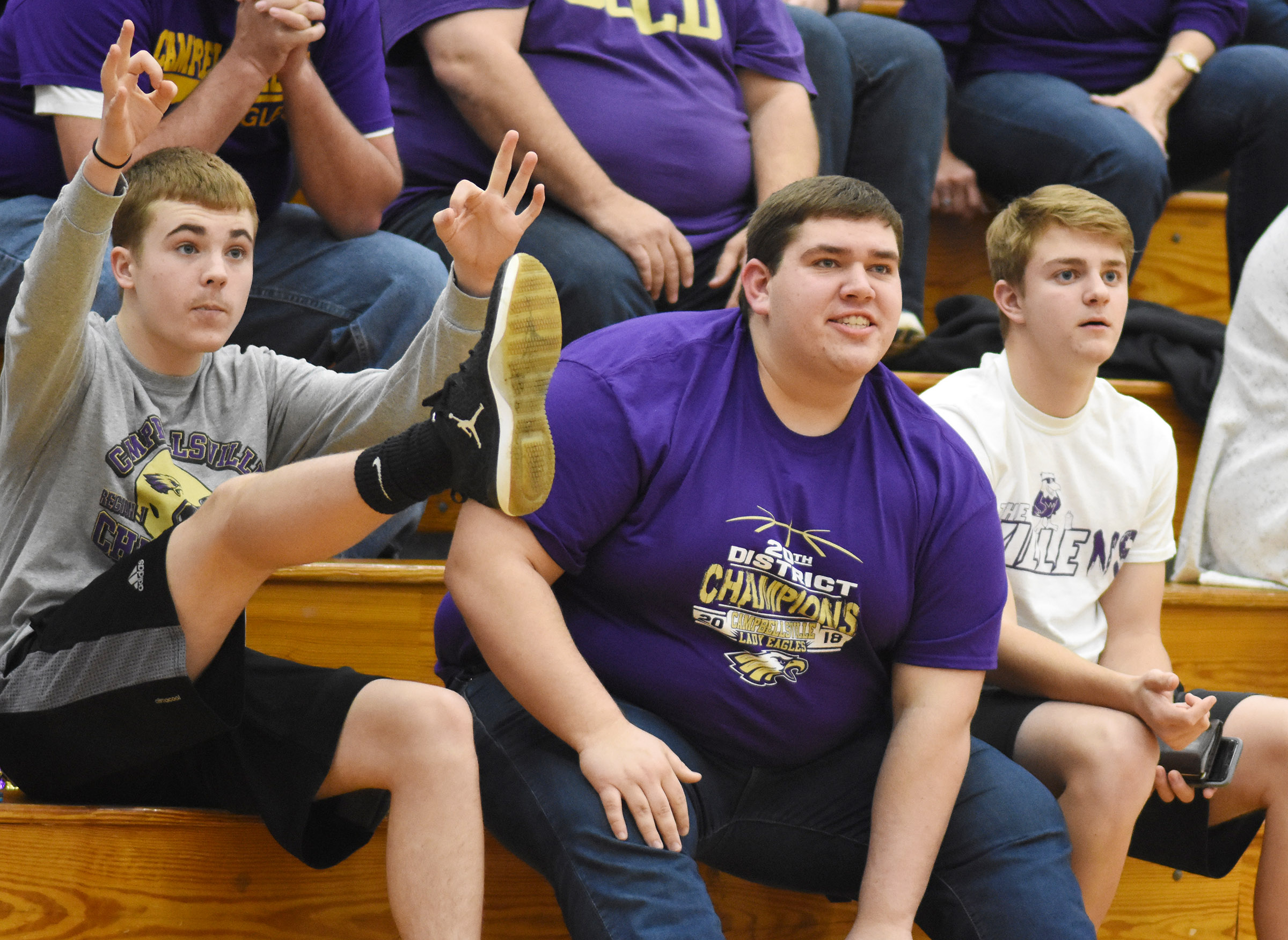 From left, CHS sophomore Tyler Gribbins and seniors Ryan Wiedewitsch and Alex Doss react to a shot.