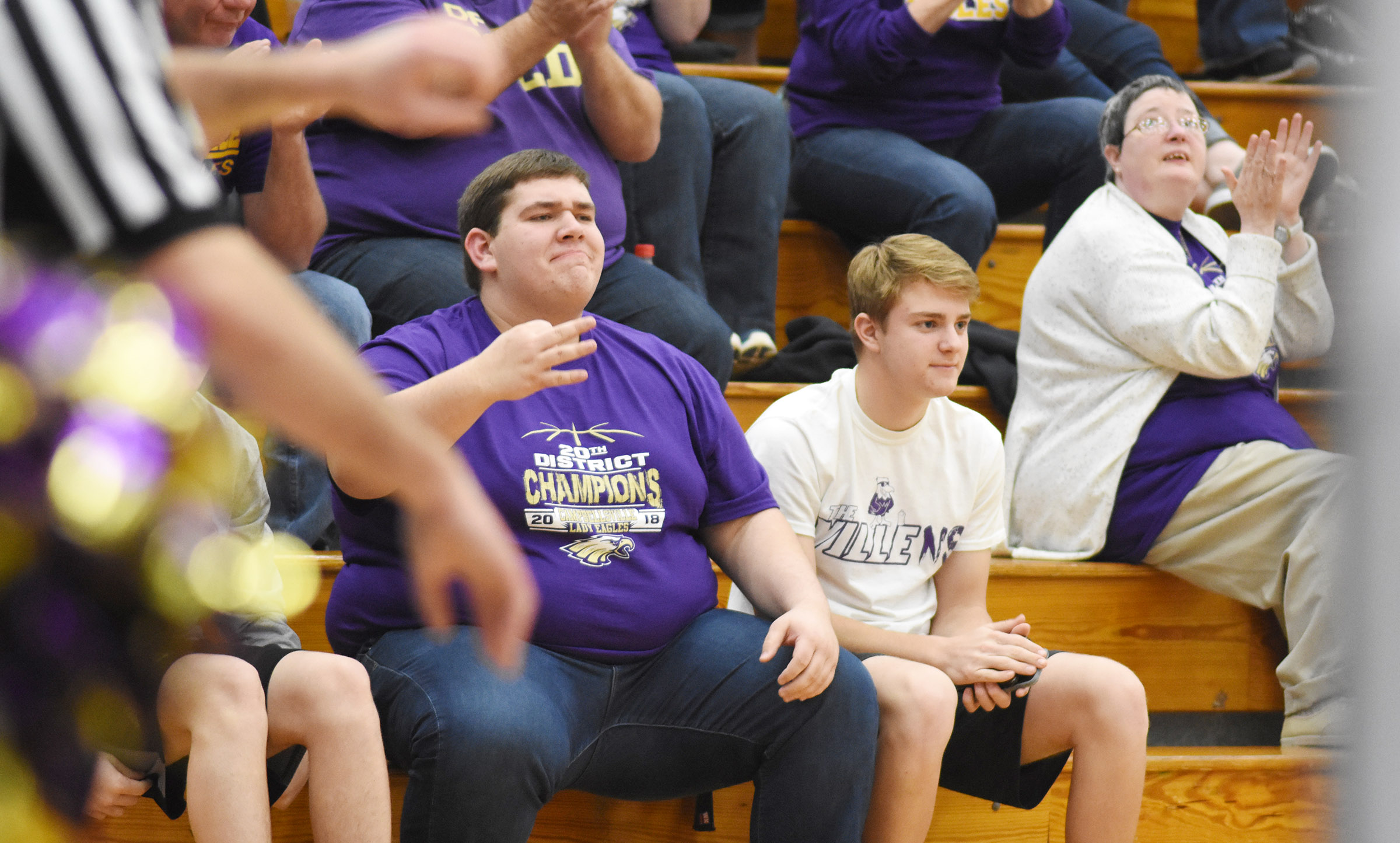 CHS seniors Ryan Wiedewitsch, at left, and Alex Doss react when the Lady Eagles make a shot.