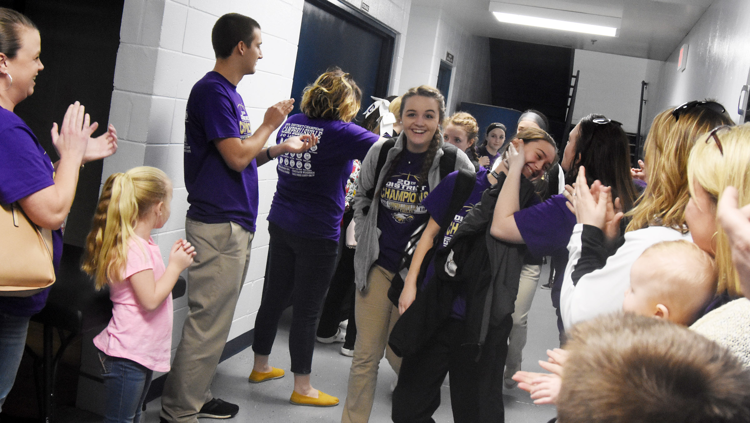 CHS freshman Kenzi Forbis, at left, and sophomore Bailey Thompson are congratulated as they walk out of the locker room.