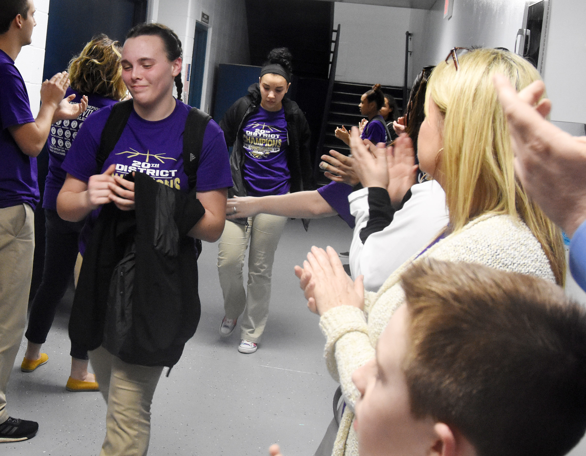 CHS sophomore Katelyn Miller is congratulated as she walks out of the locker room.