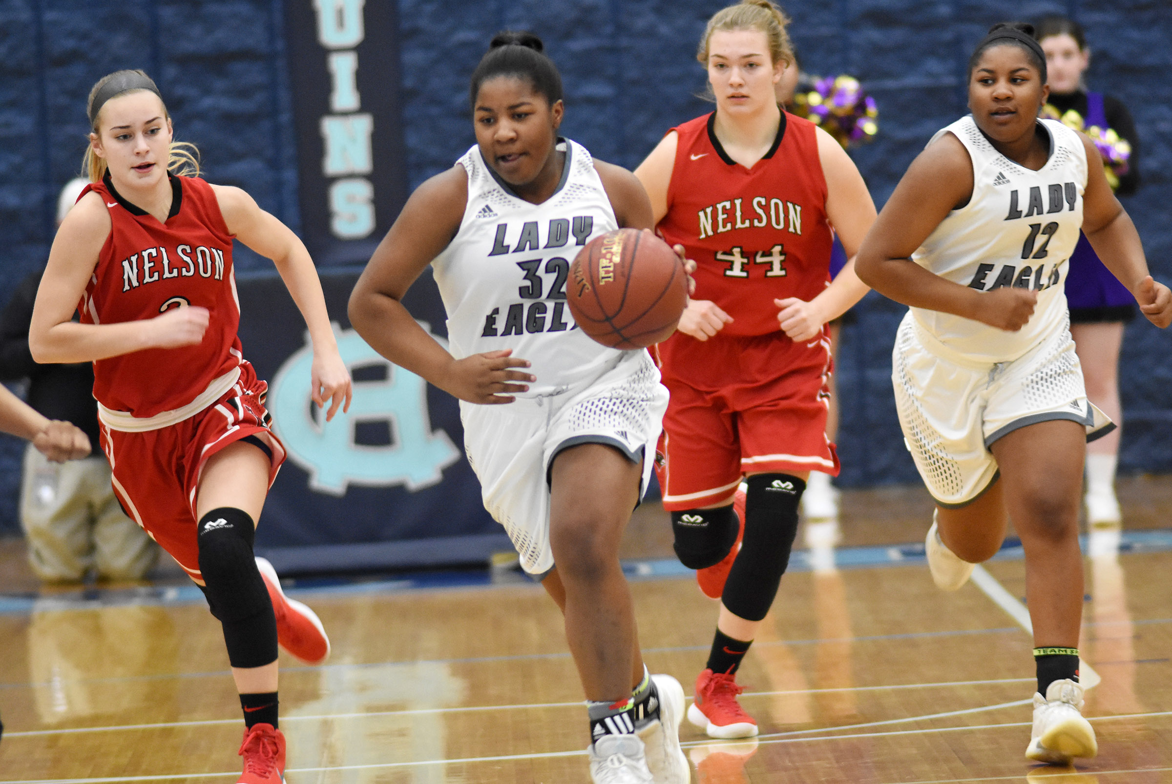 CHS senior Nena Barnett dribbles down the court, with her twin sister, senior Kiyah Barnett, not far behind.