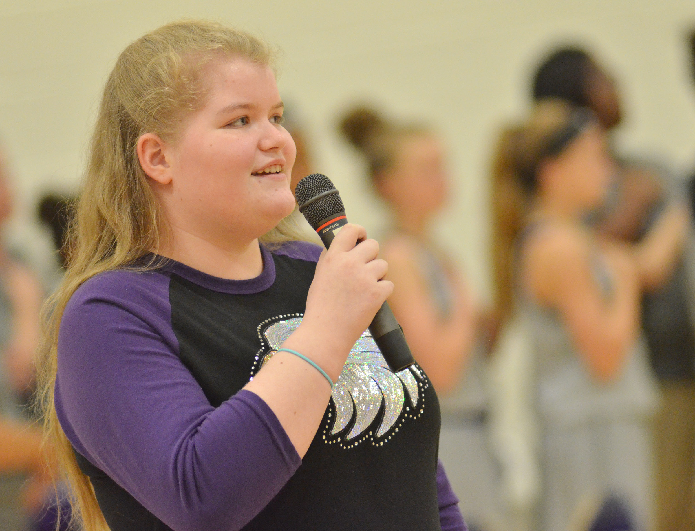 CMS seventh-grader Aubrey Young sings the National Anthem.