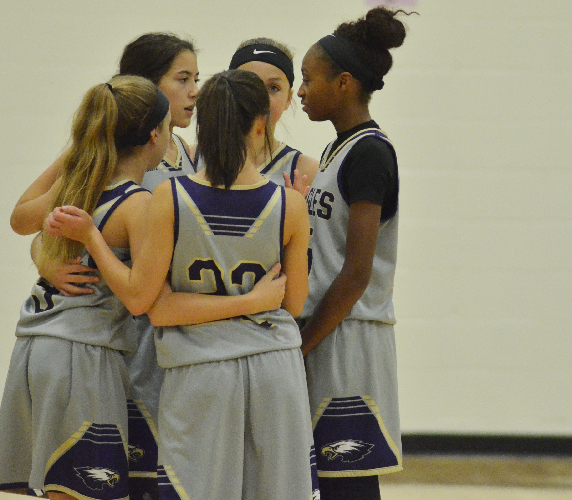 CMS eighth-grade players huddle before their game begins.