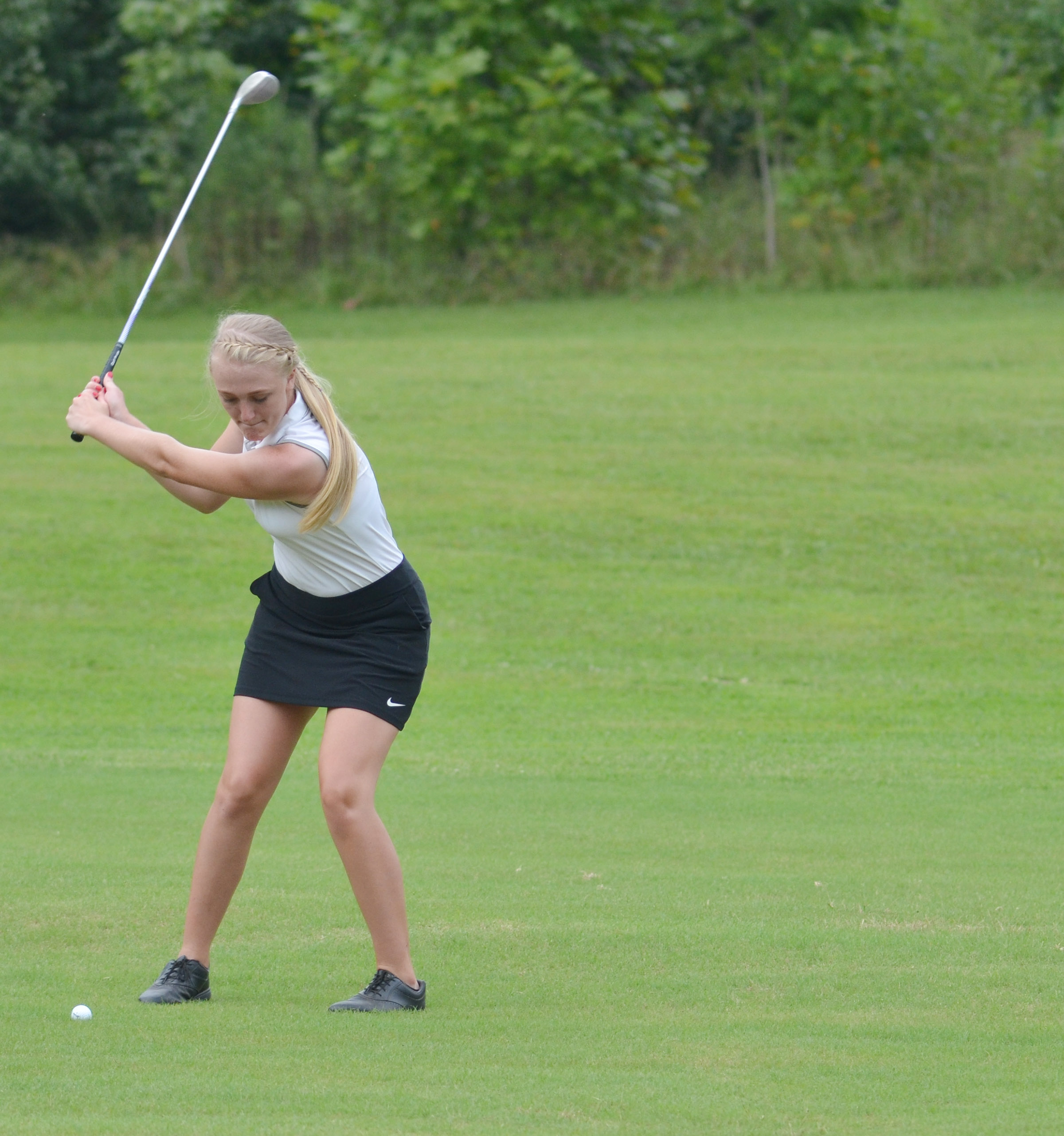 "CHS junior Abbie Dicken hits the ball onto the green in the All ""A"" region tournament."