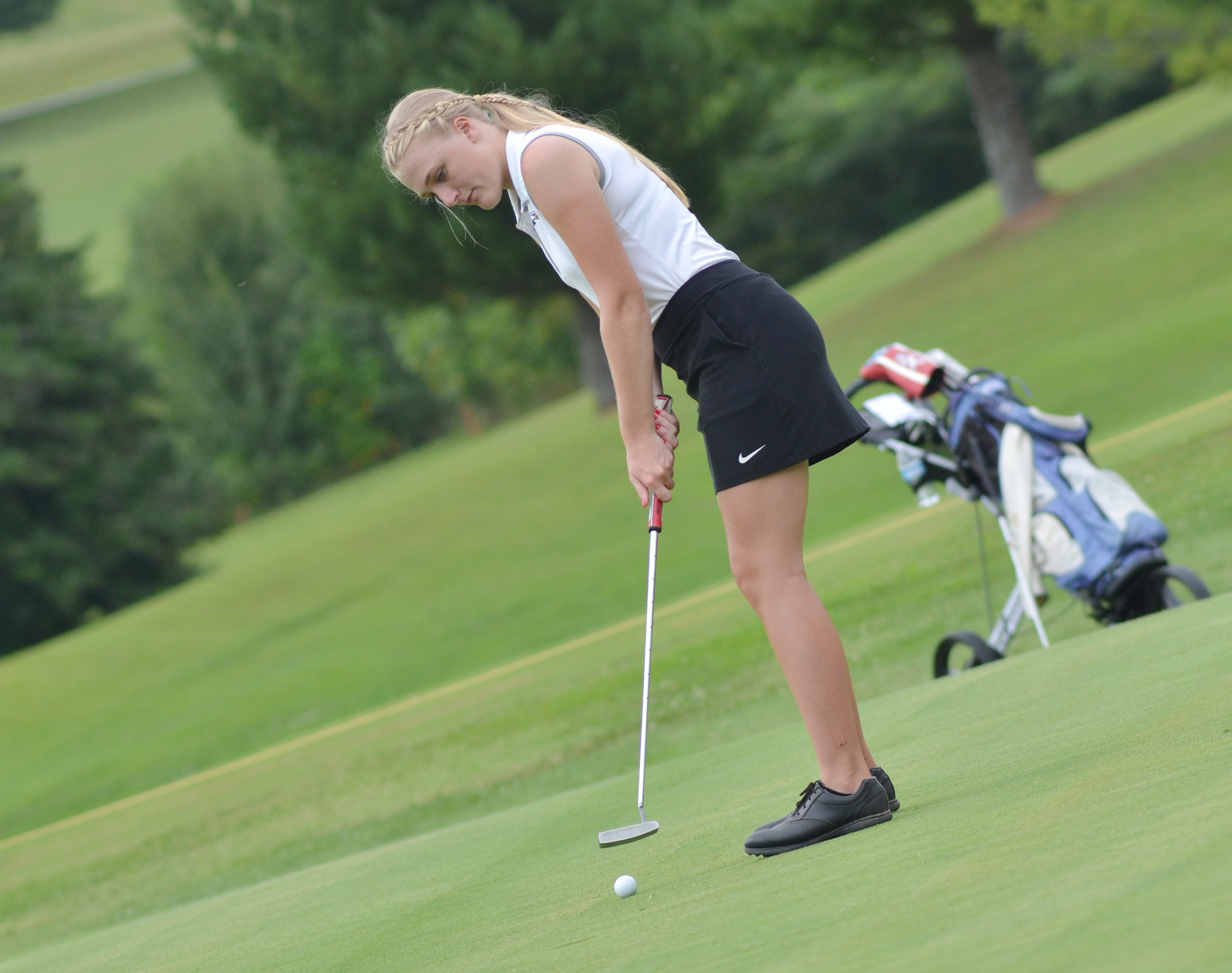 "CHS junior Abbie Dicken putts in the All ""A"" region tournament."