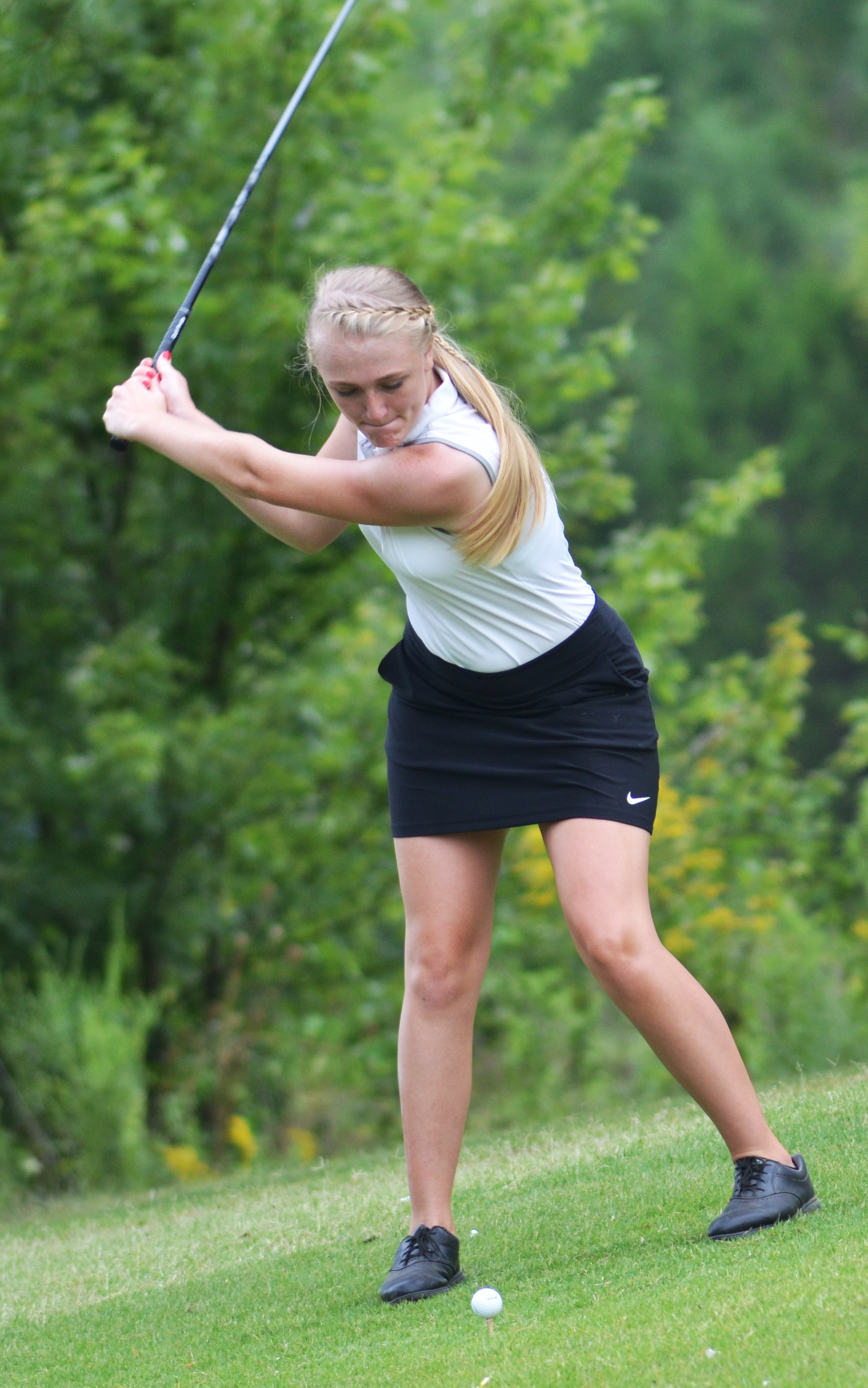 "CHS junior Abbie Dicken tees off in the All ""A"" region tournament."