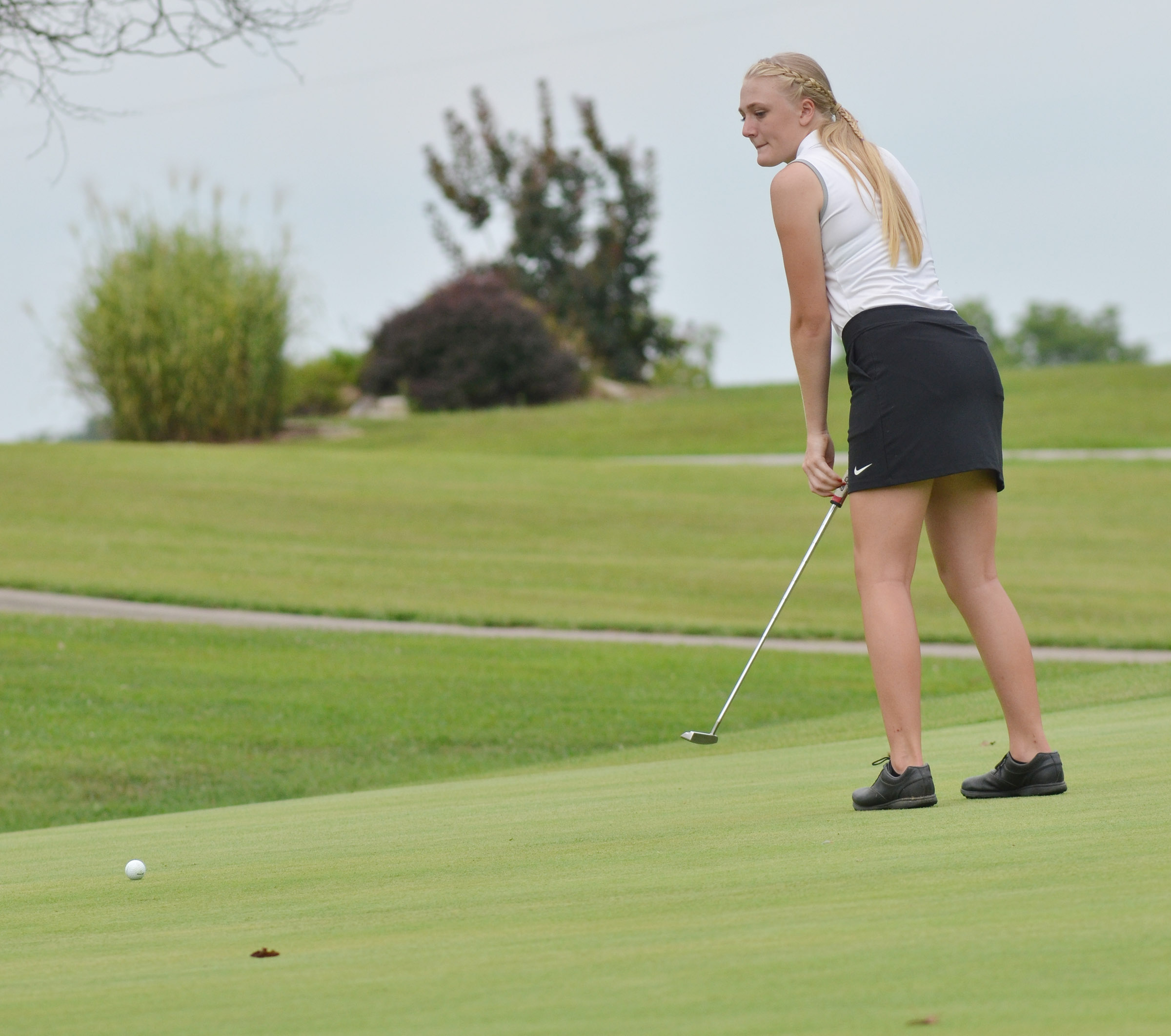 "CHS junior Abbie Dicken putts in the All ""A' region tournament."