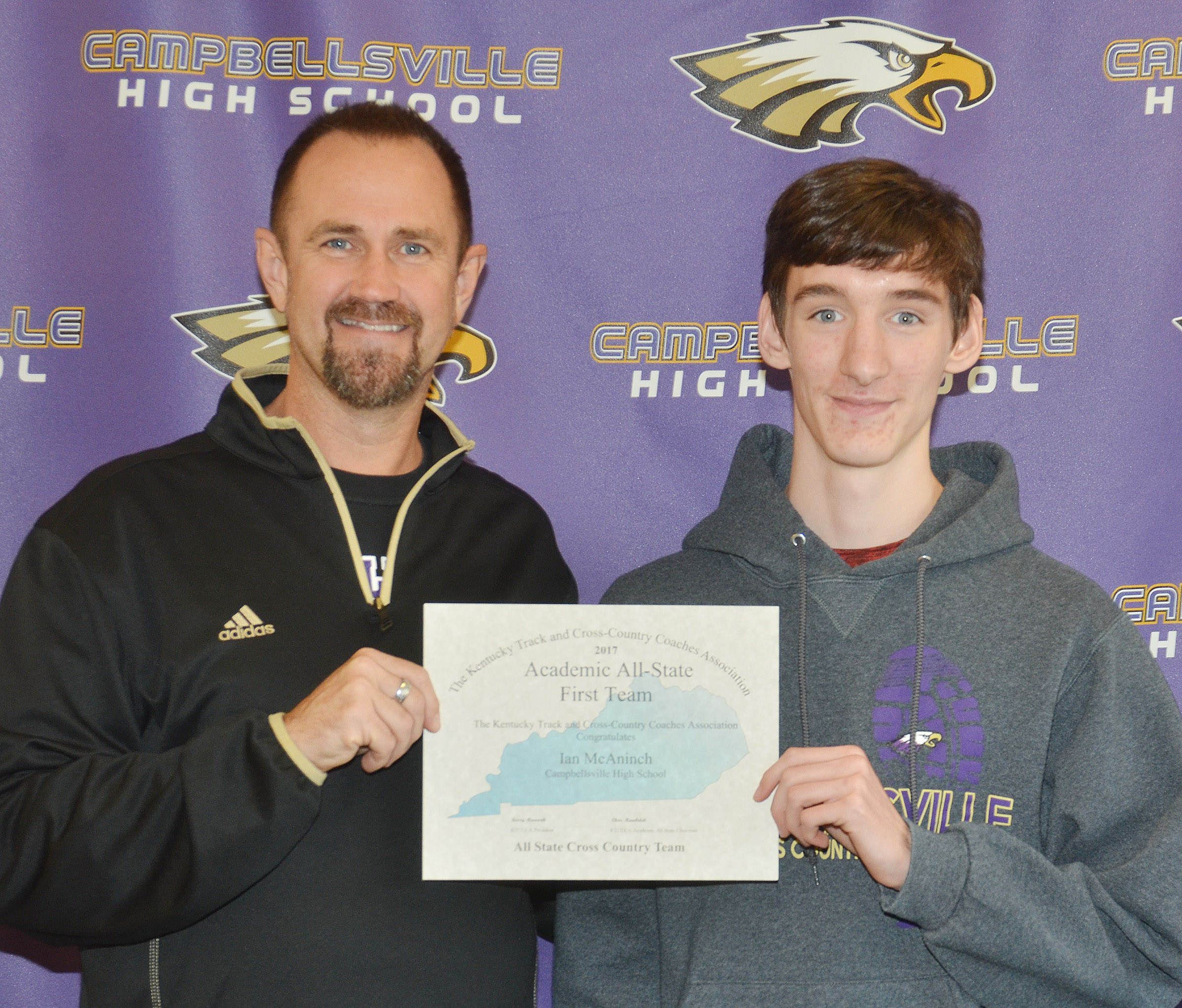 The Kentucky Track and Cross Country Coaches Association recently named Ian McAninch, a CHS junior, at right, to the Academic All-State First Team. At left is CHS cross country coach Steve Doss.