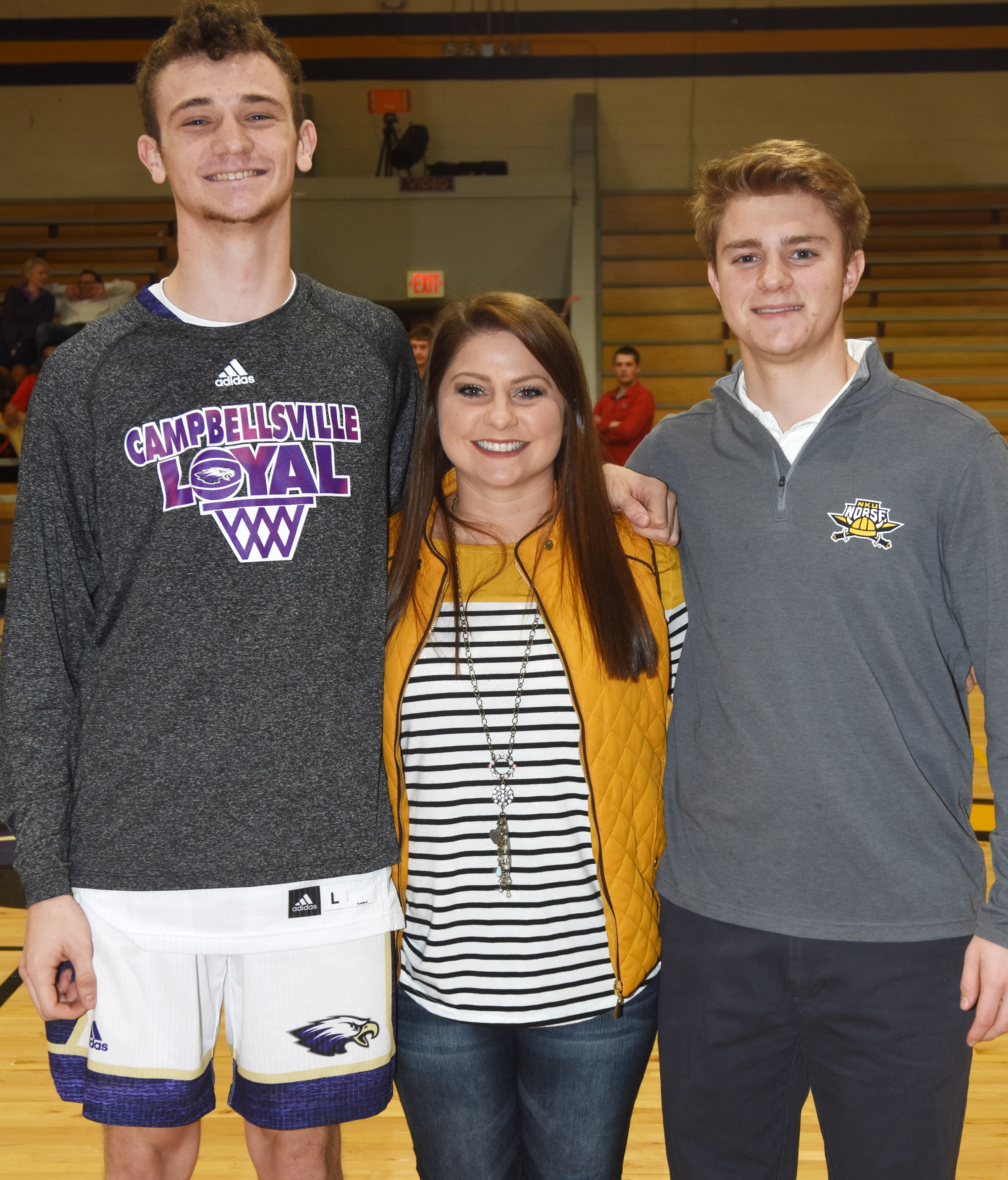 CHS senior golf players Connor Wilson, at left, and Alex Doss are pictured with boys' golf coach Cassidy Decker.