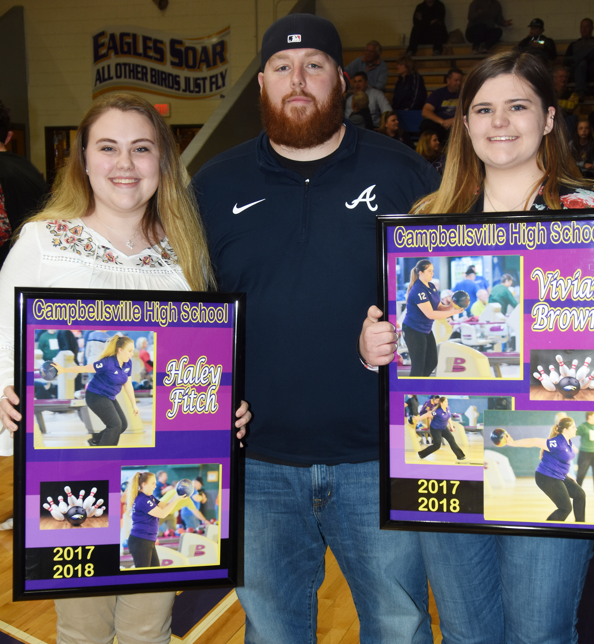 CHS senior bowling team members Haley Fitch, at left, and Vivian Brown are pictured with head coach Stephen Tucker.