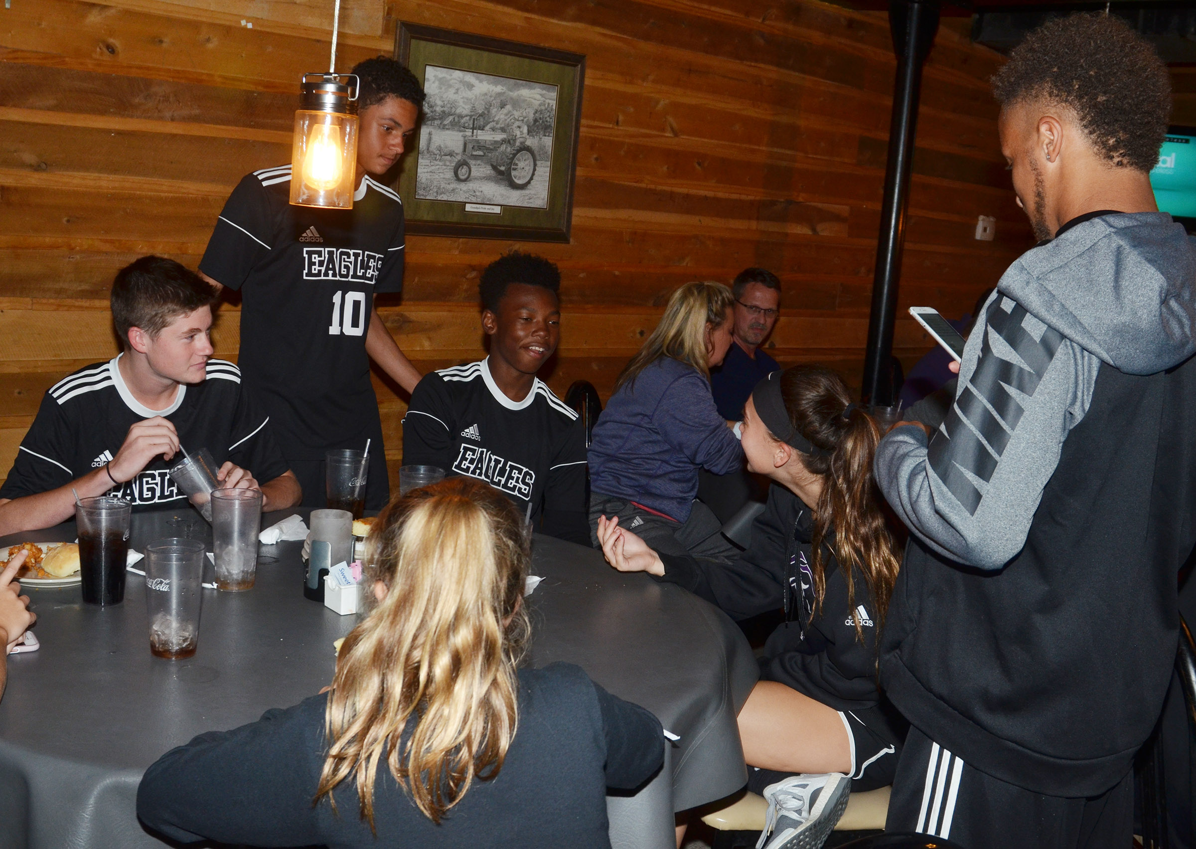 CHS soccer players and family members celebrate at Creek Side Restaurant.