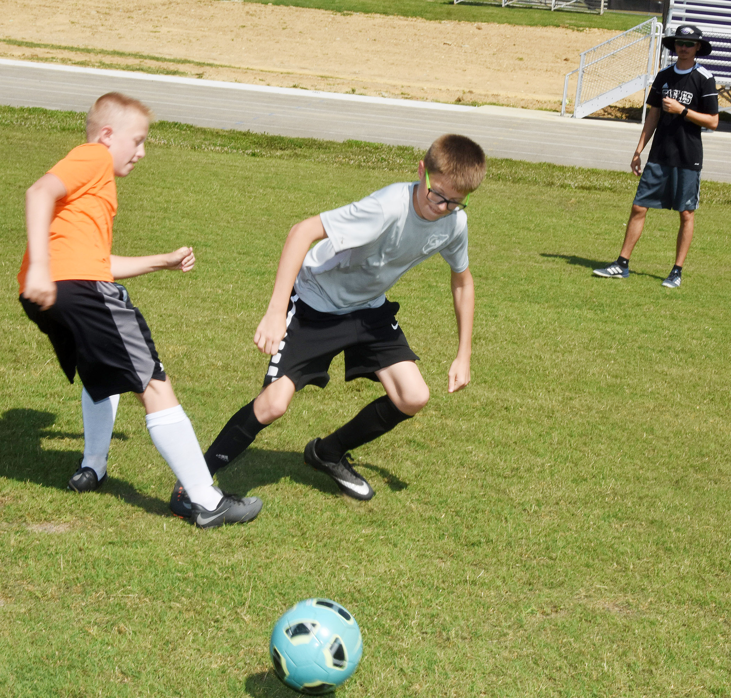 Zander Smith, at left, and Campbellsville Middle School sixth-grader Ethan Murphy compete for the ball.