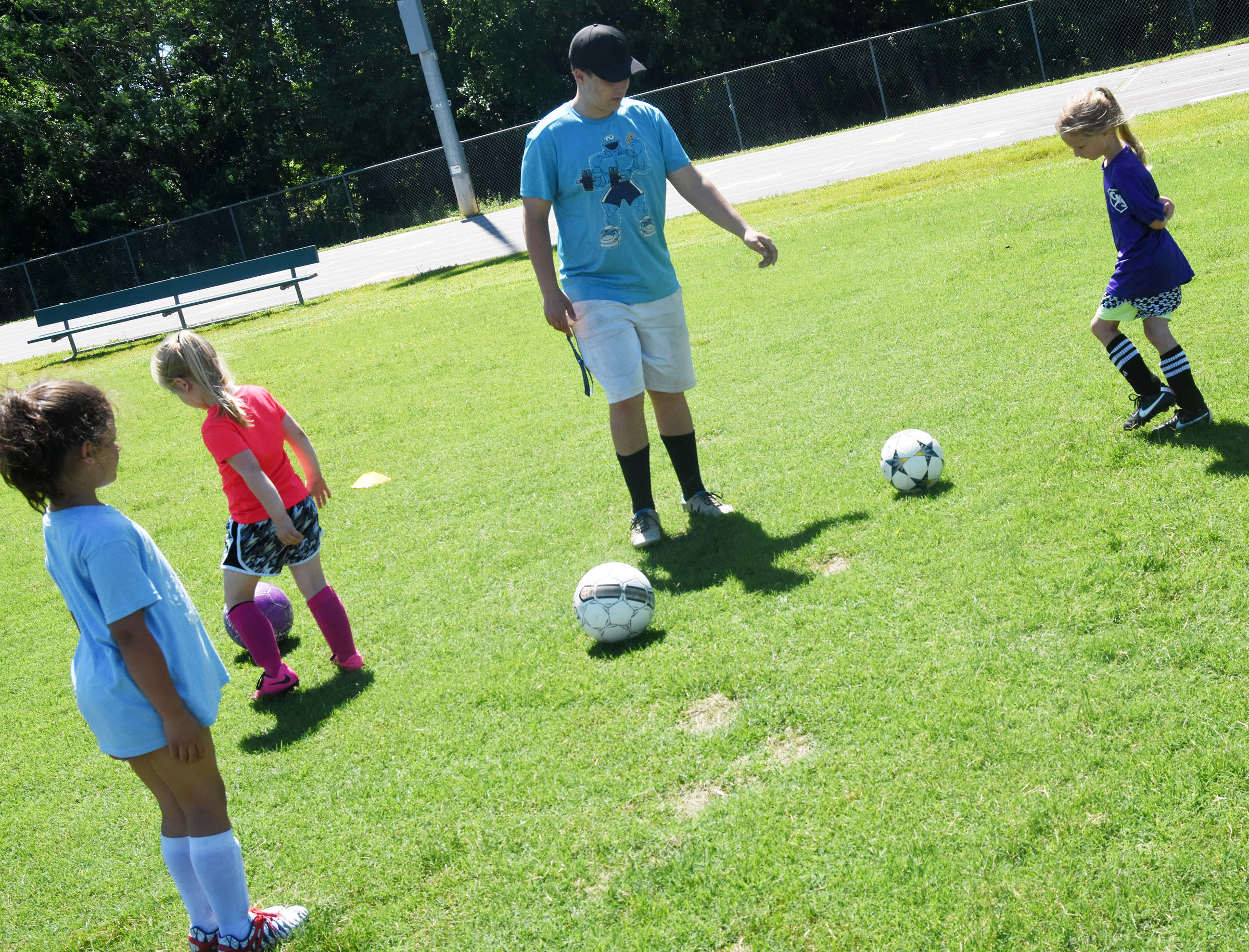 CHS senior soccer player Brody Week leads a drill.