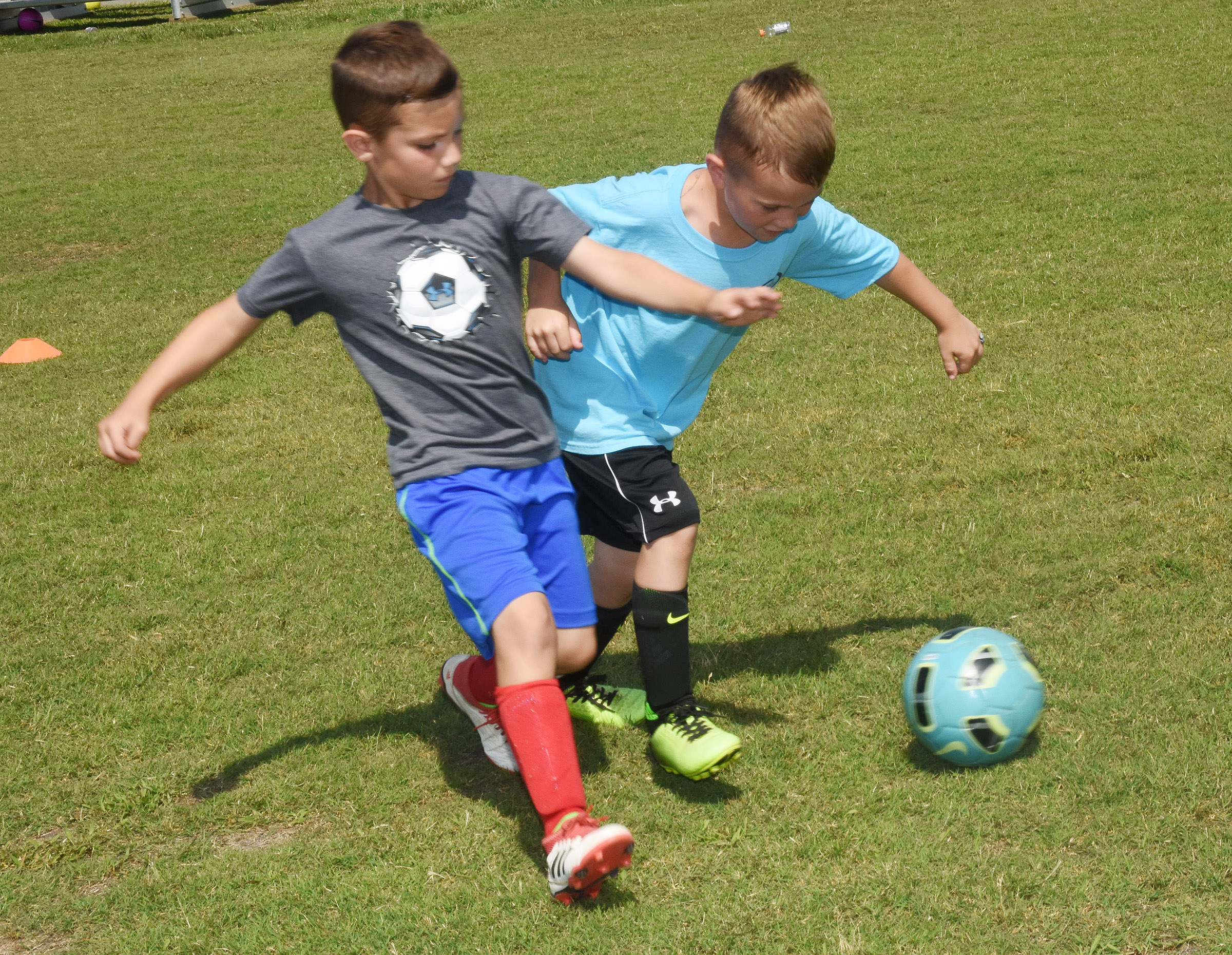 Campbellsville Elementary School second-grader Owen Skaggs, at left, and Owen Smith compete in a drill.