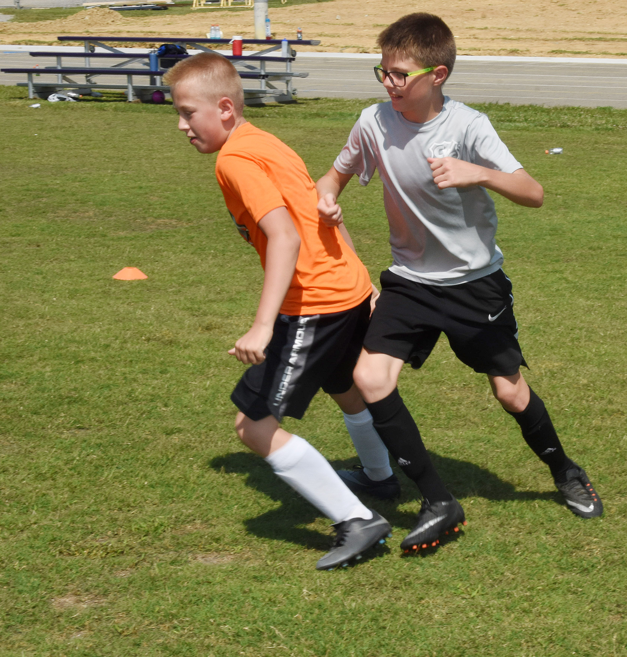 Zander Smith, at left, and Campbellsville Middle School sixth-grader Ethan Murphy compete in a drill.