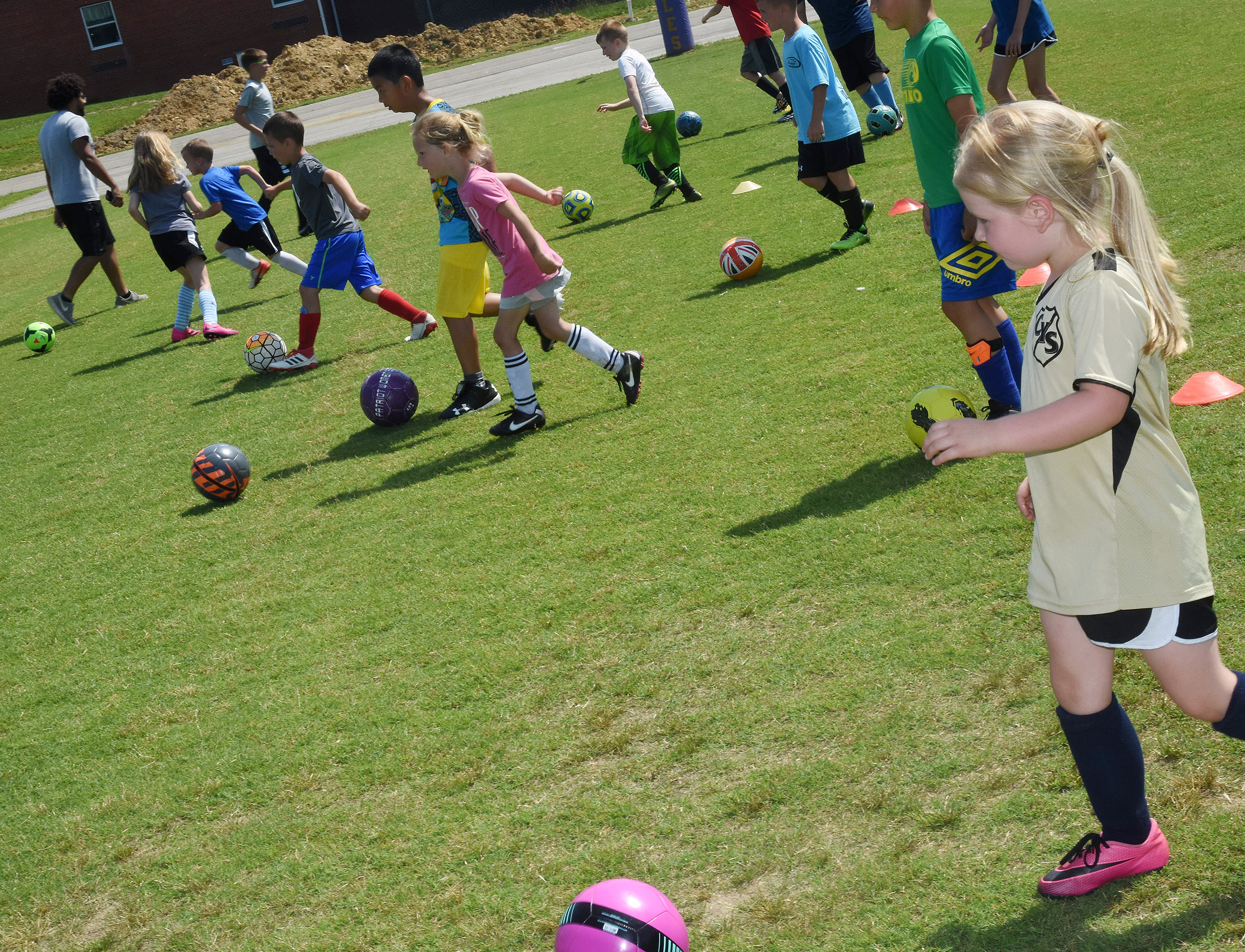 CHS soccer youth campers compete in a drill.