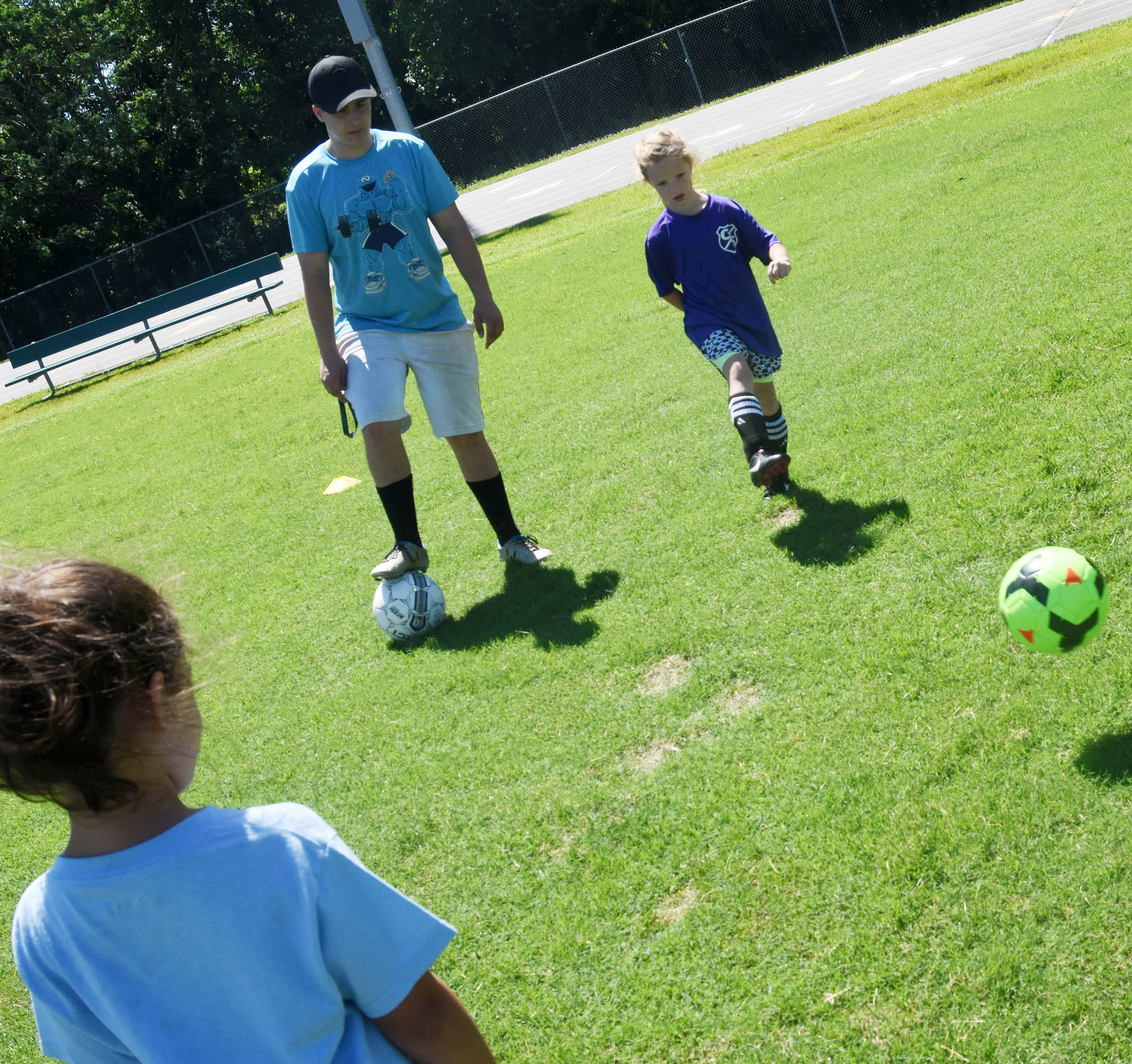 CHS senior soccer player Brody Weeks leads a drill as Joy Graham kicks the ball.
