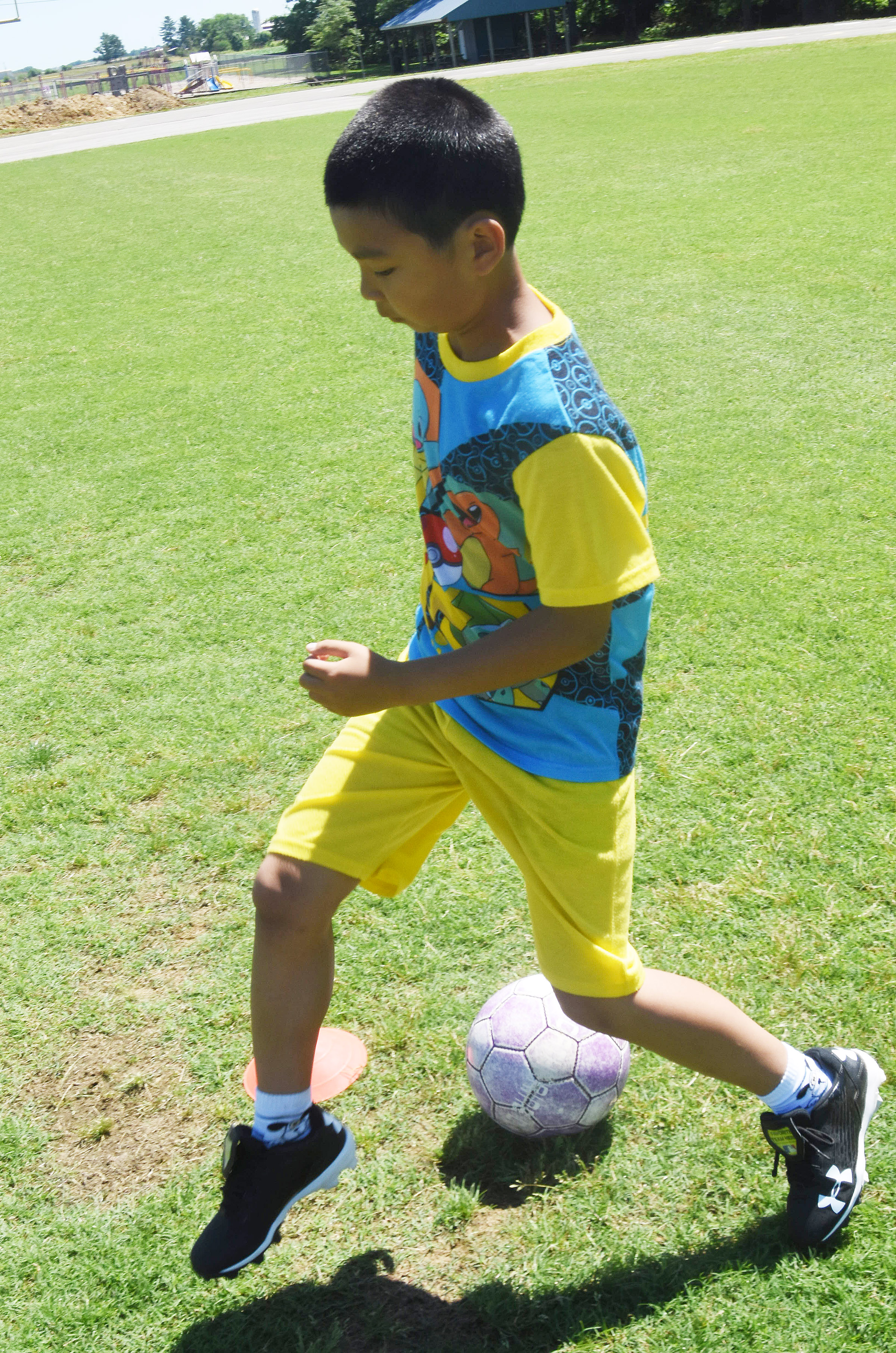 Campbellsville Elementary School fourth-grader Alfie Su kicks the ball during a drill.