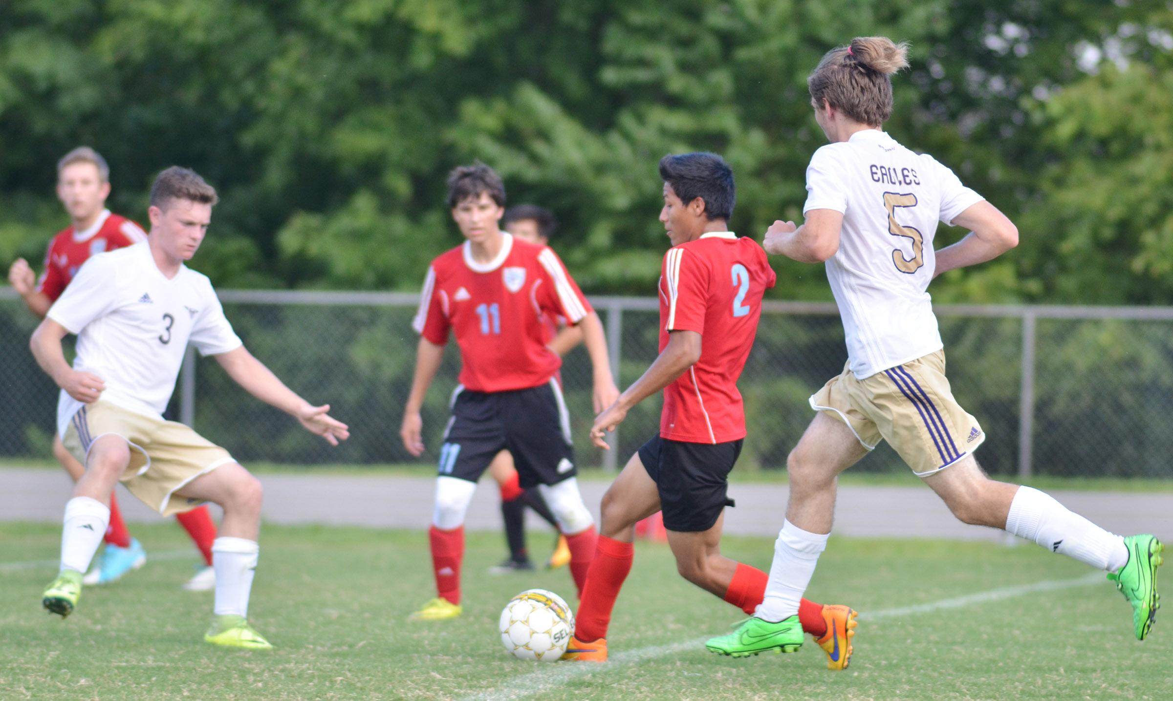 CHS seniors Bryce Richardson, at left, and Christian Berry play defense.