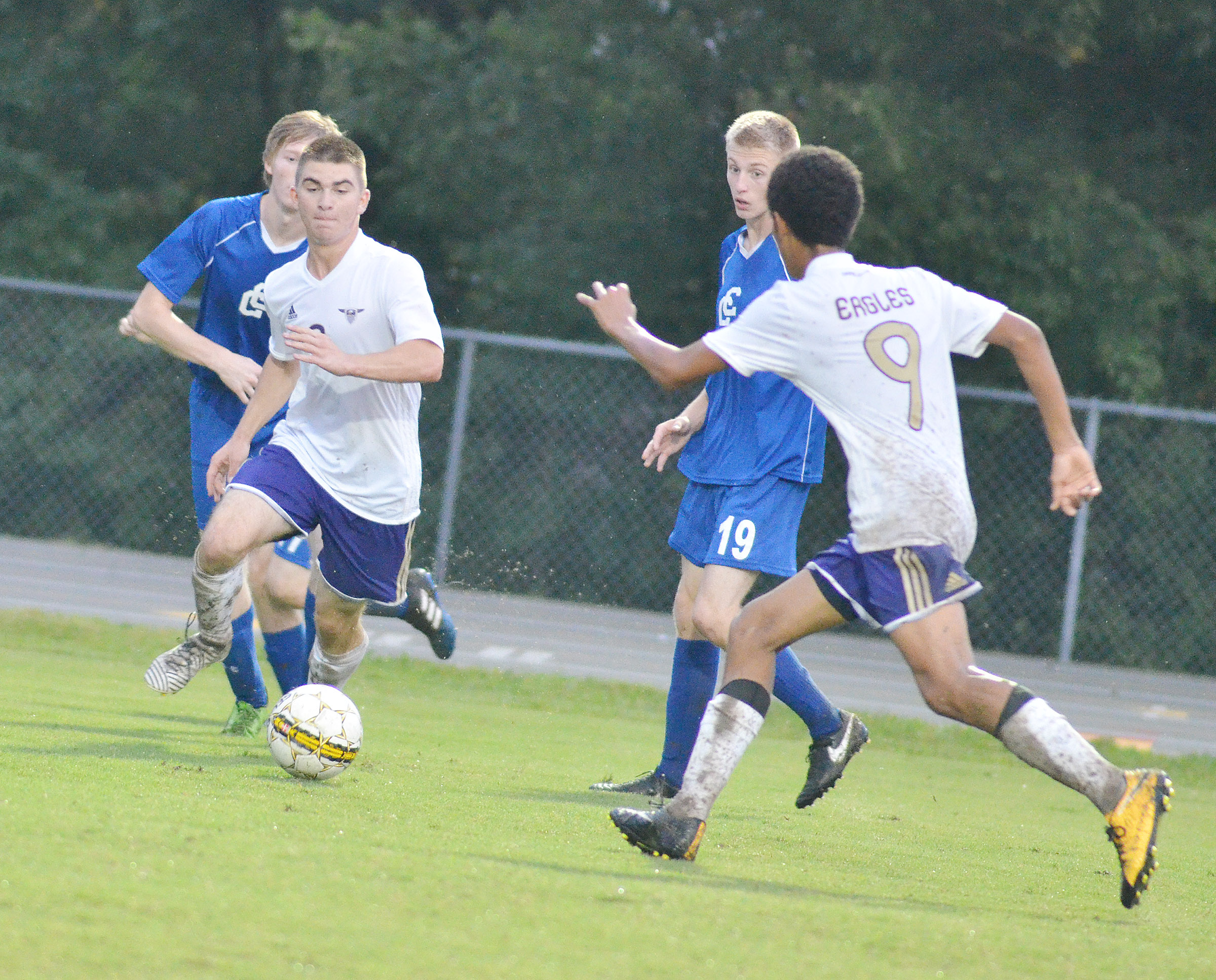CHS senior Cass Kidwell, at left, and sophomore David Silva run for the ball.