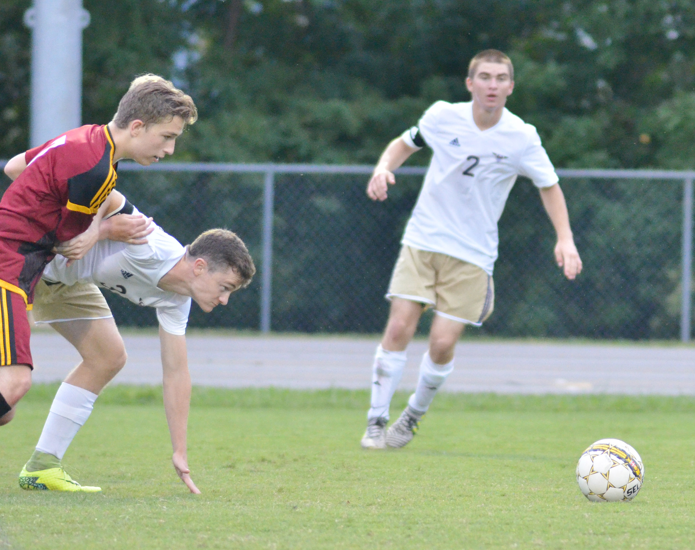 CHS senior Bryce Richardson battles for the ball, as classmate Cass Kidwell stays close.
