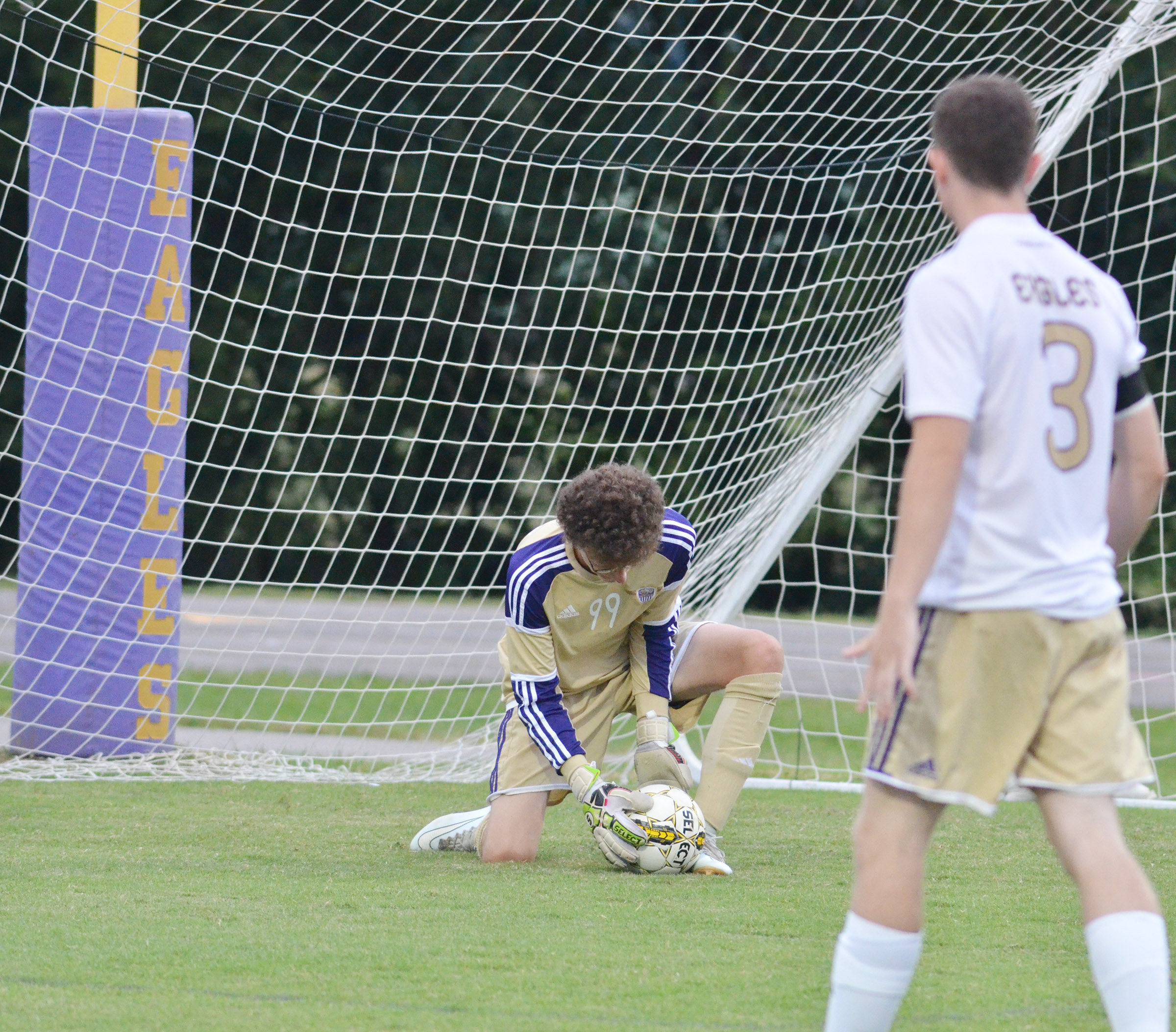 CHS sophomore Brennon Wheeler catches a goal attempt.