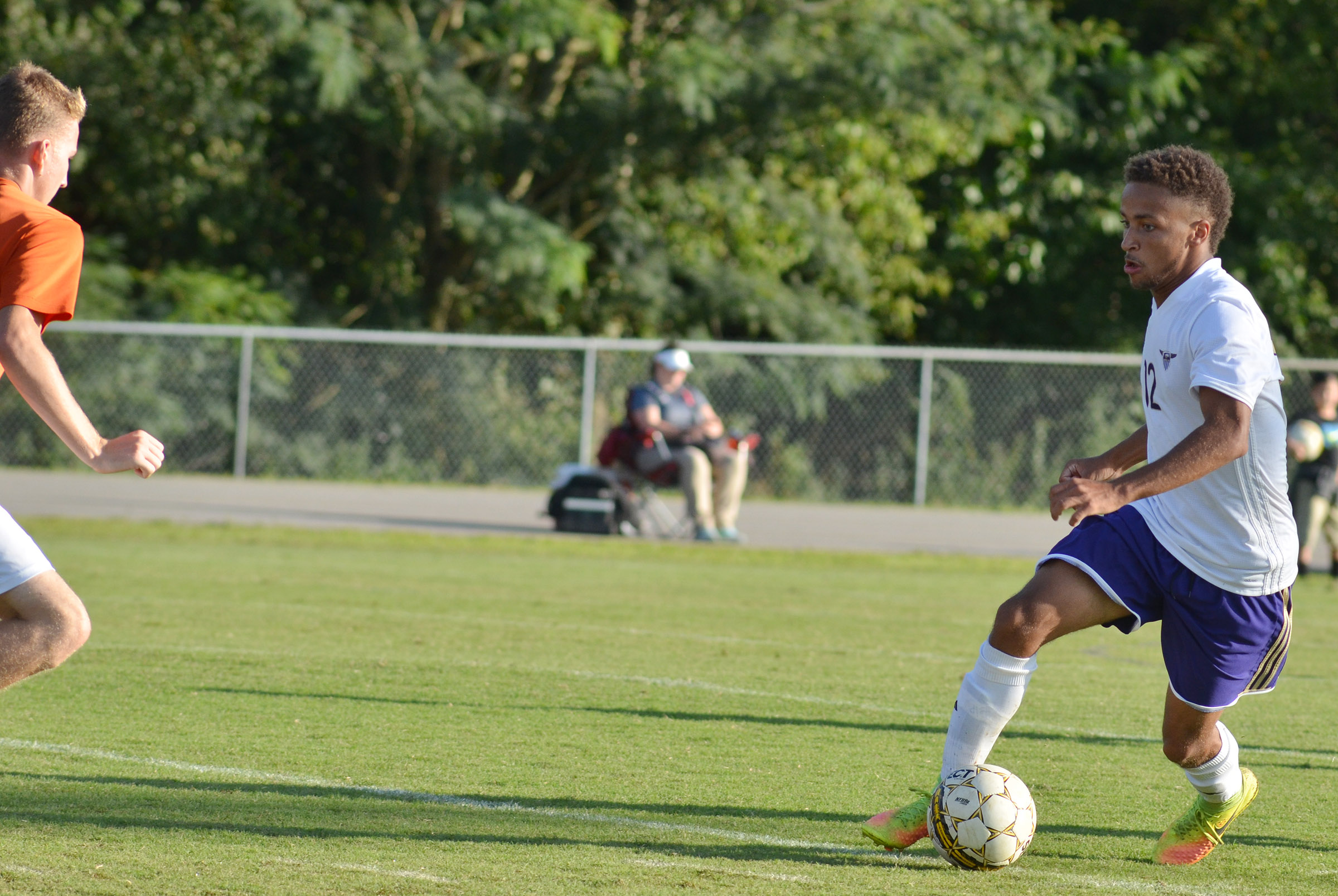 CHS senior Ethan Lay kicks the ball toward the goal.