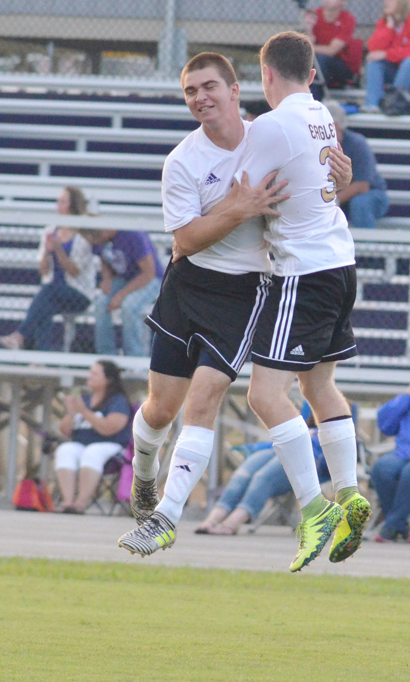 CHS seniors Cass Kidwell, at left, and Bryce Richardson celebrate a goal.