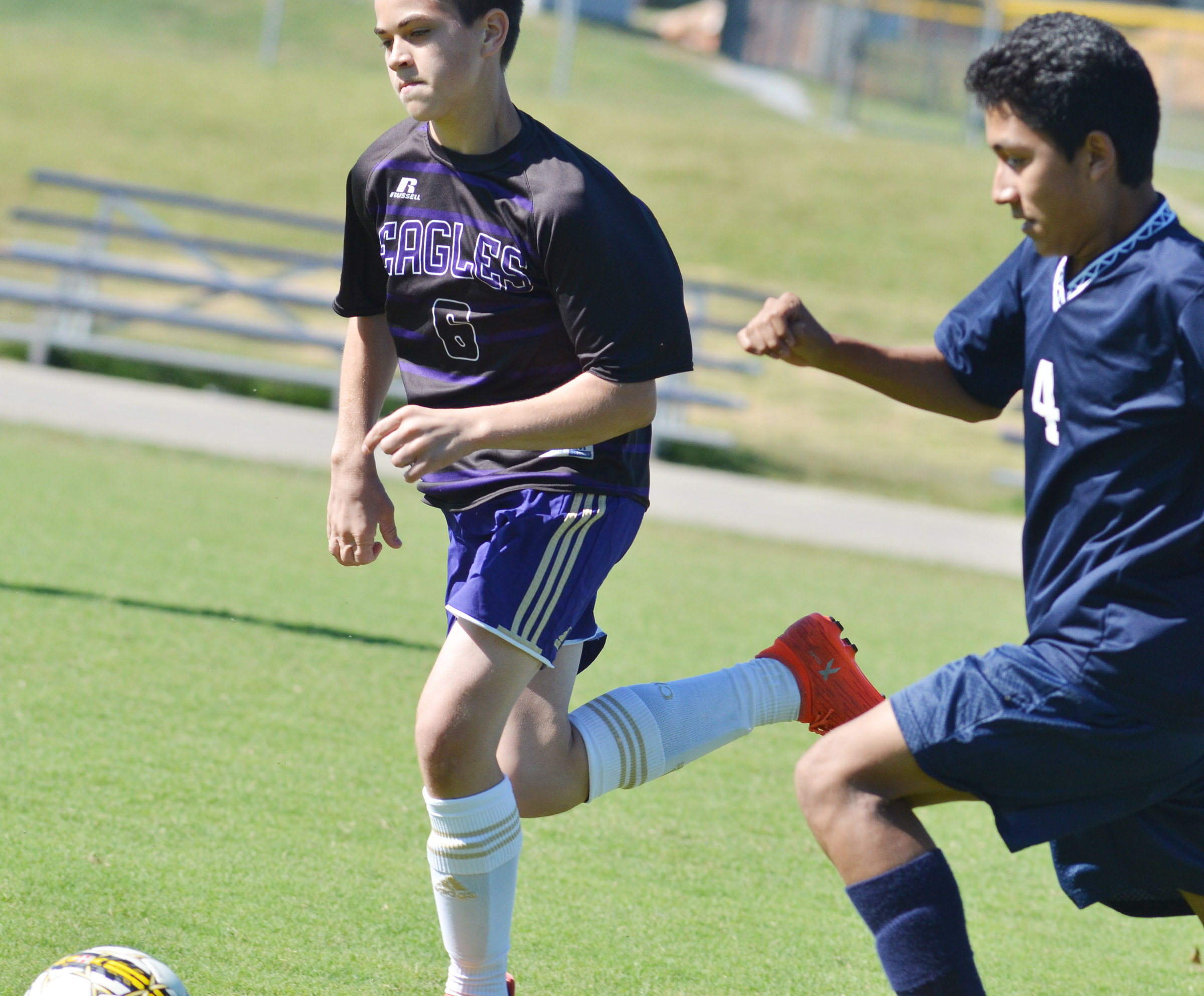 CHS freshman Clark Kidwell kicks the ball.