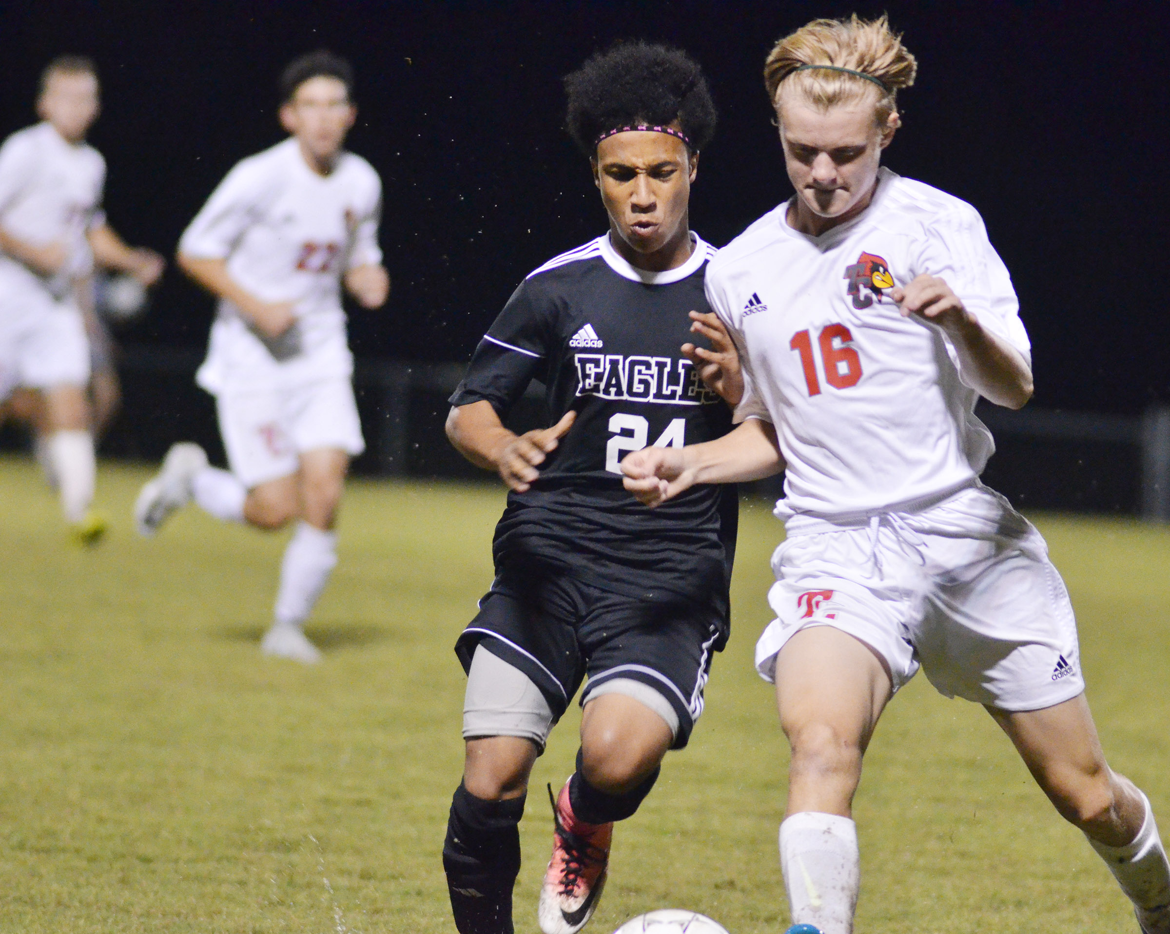 CHS junior Daniel Johnson battles for the ball.