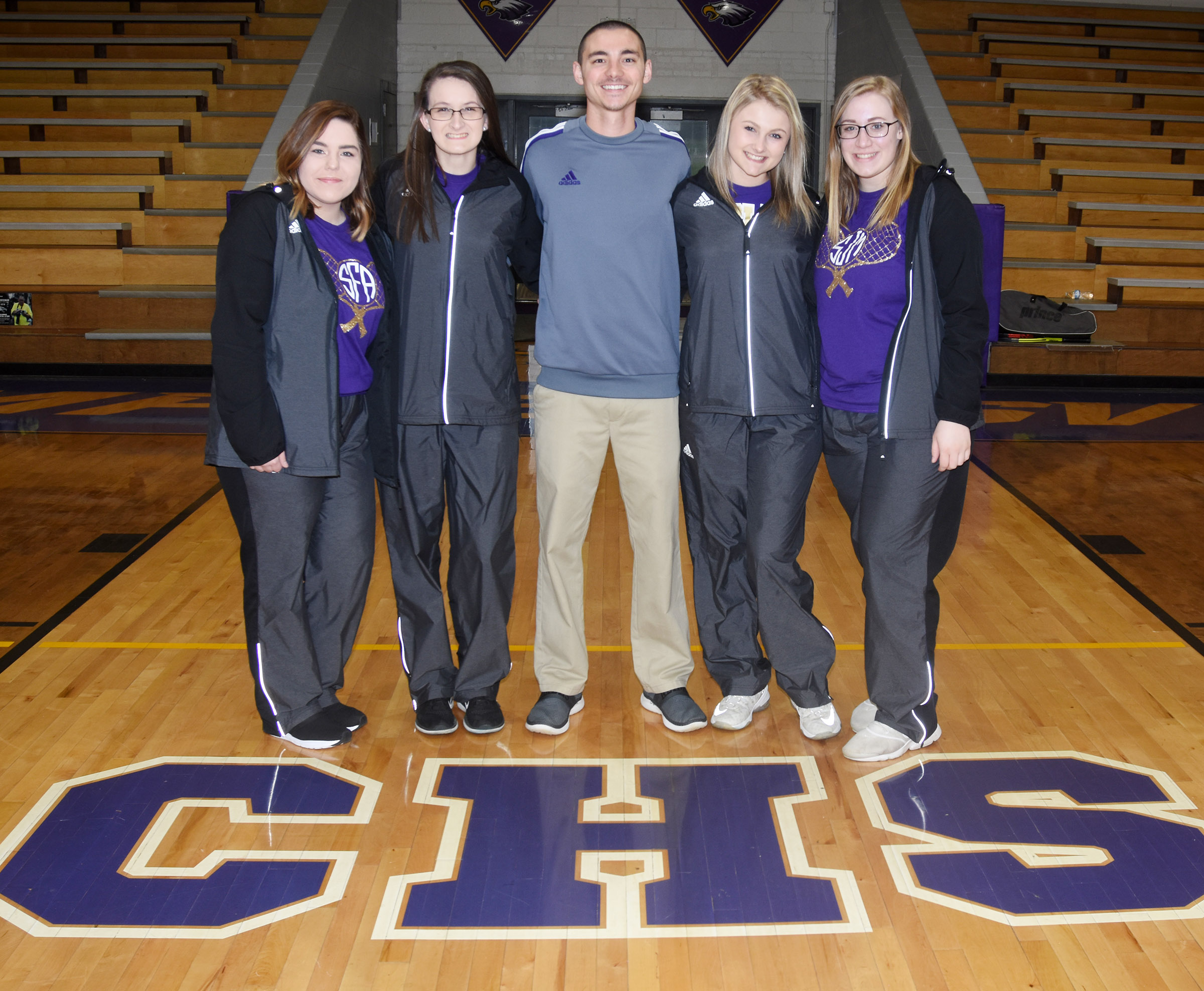 CHS girls' tennis team includes, from left, seniors Sara Farmer and Kimberly Harden, coach Bradley Harris and sophomores Victoria Cox and Samantha Johnson.